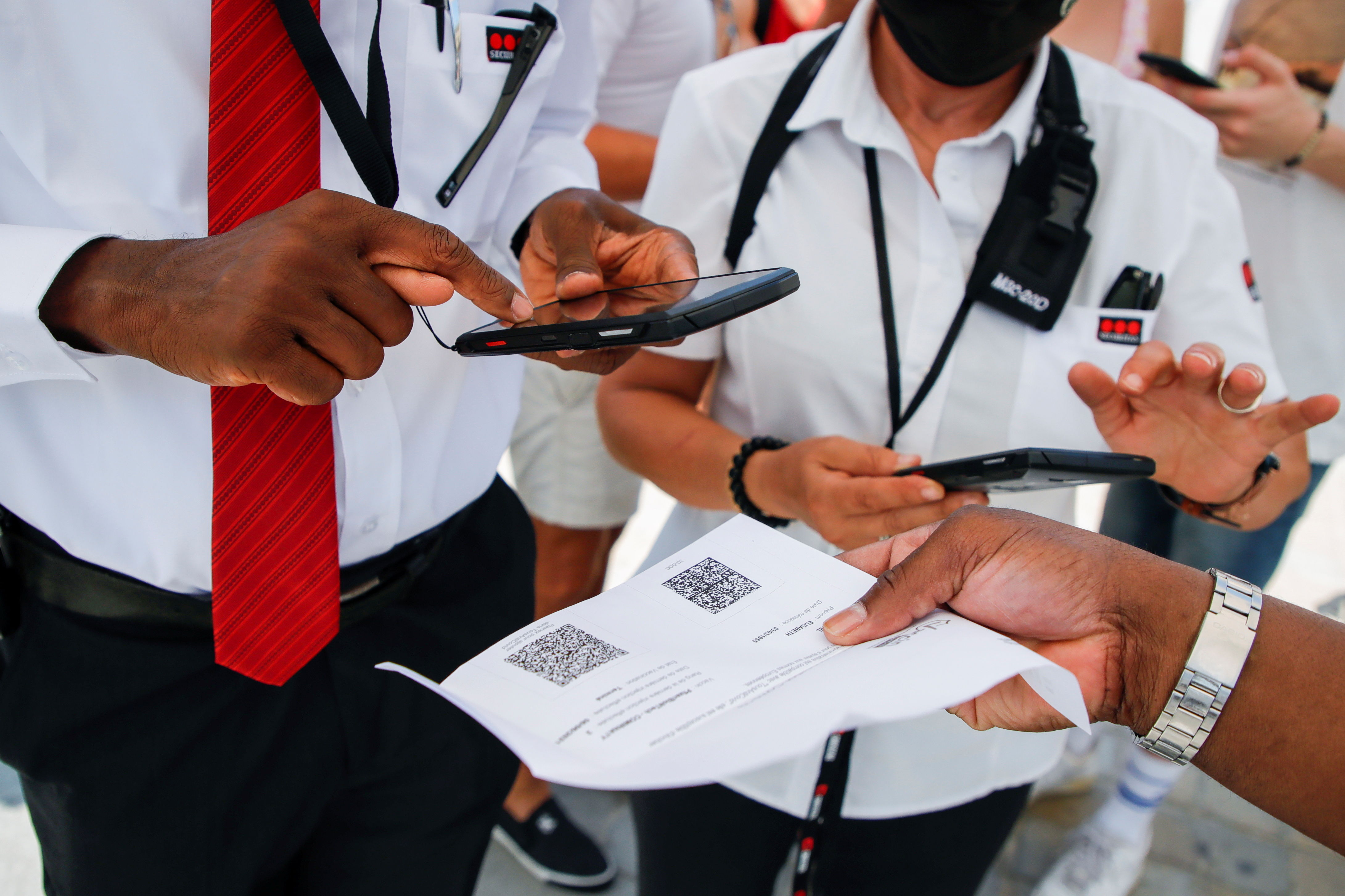 Security agents check visitors' health passes in front of the Louvre museum entrance amid the coronavirus disease (COVID-19) outbreak in Paris, France, July 21, 2021. REUTERS/Sarah Meyssonnier