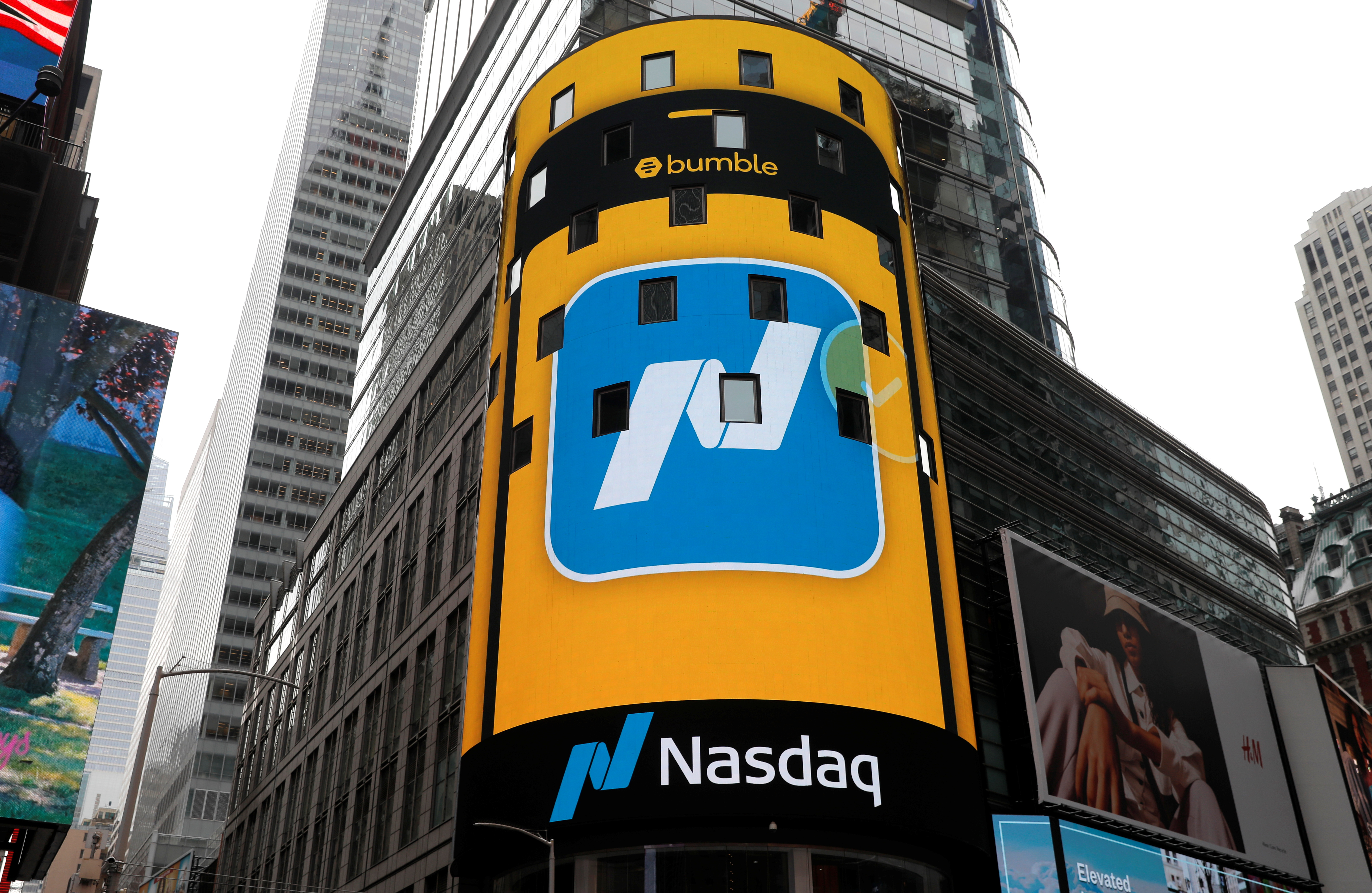 The display outside the Nasdaq MarketSite is pictured as the dating app operator Bumble Inc. (BMBL) made its debut on the Nasdaq stock exchange during the company's IPO in New York City, New York, U.S., February 11, 2021. REUTERS/Mike Segar