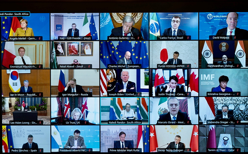 A screen displays international leaders as they take part virtually in an extraordinary G20 leaders meeting on Afghanistan, in Rome, Italy, October 12, 2021. Filippo Attili/Palazzo Chigi Press Office/Handout via REUTERS