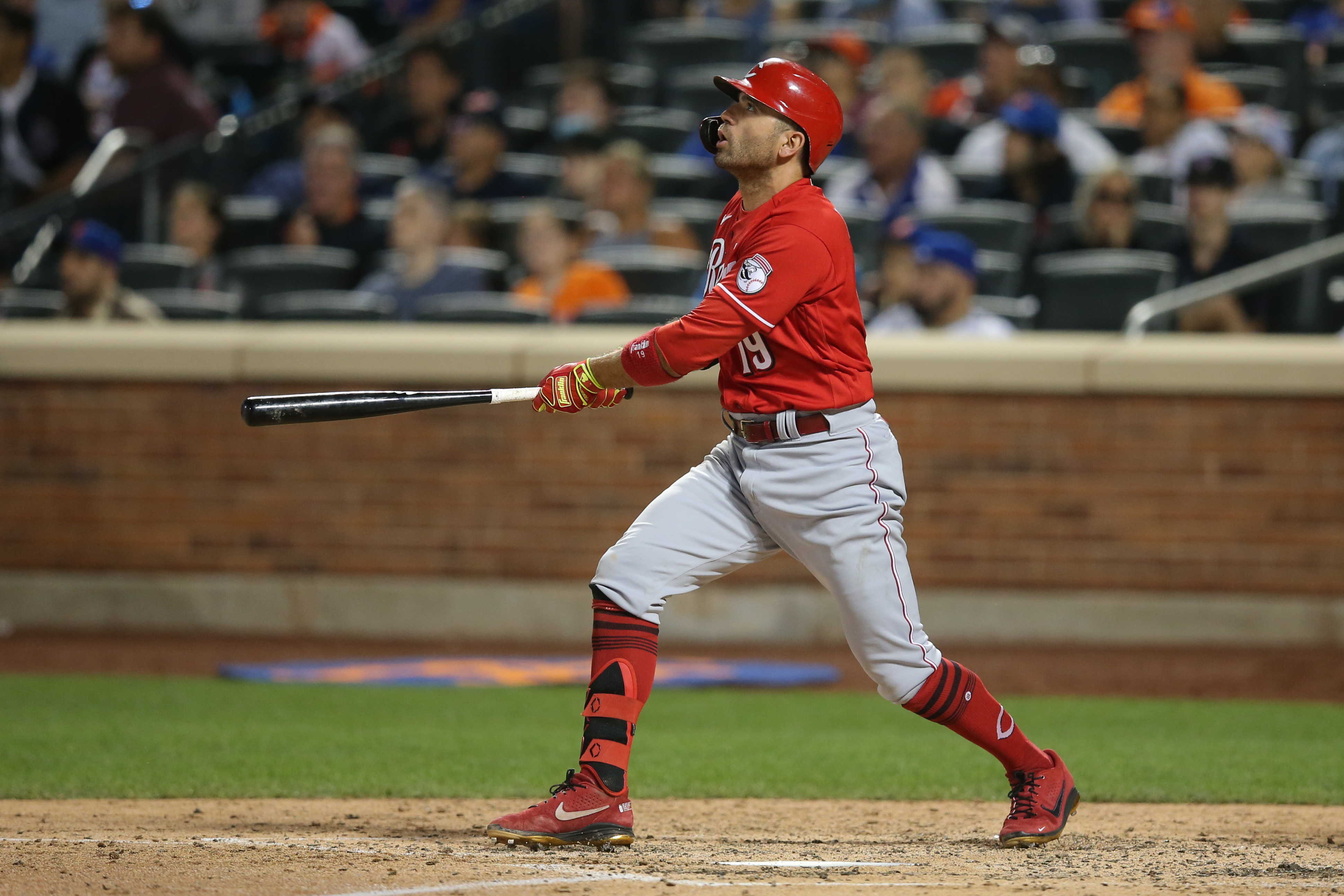 Jul 30, 2021; New York City, New York, USA; Cincinnati Reds first baseman Joey Votto (19) follows through on a solo home run against the New York Mets during the sixth inning at Citi Field. Mandatory Credit: Brad Penner-USA TODAY Sports