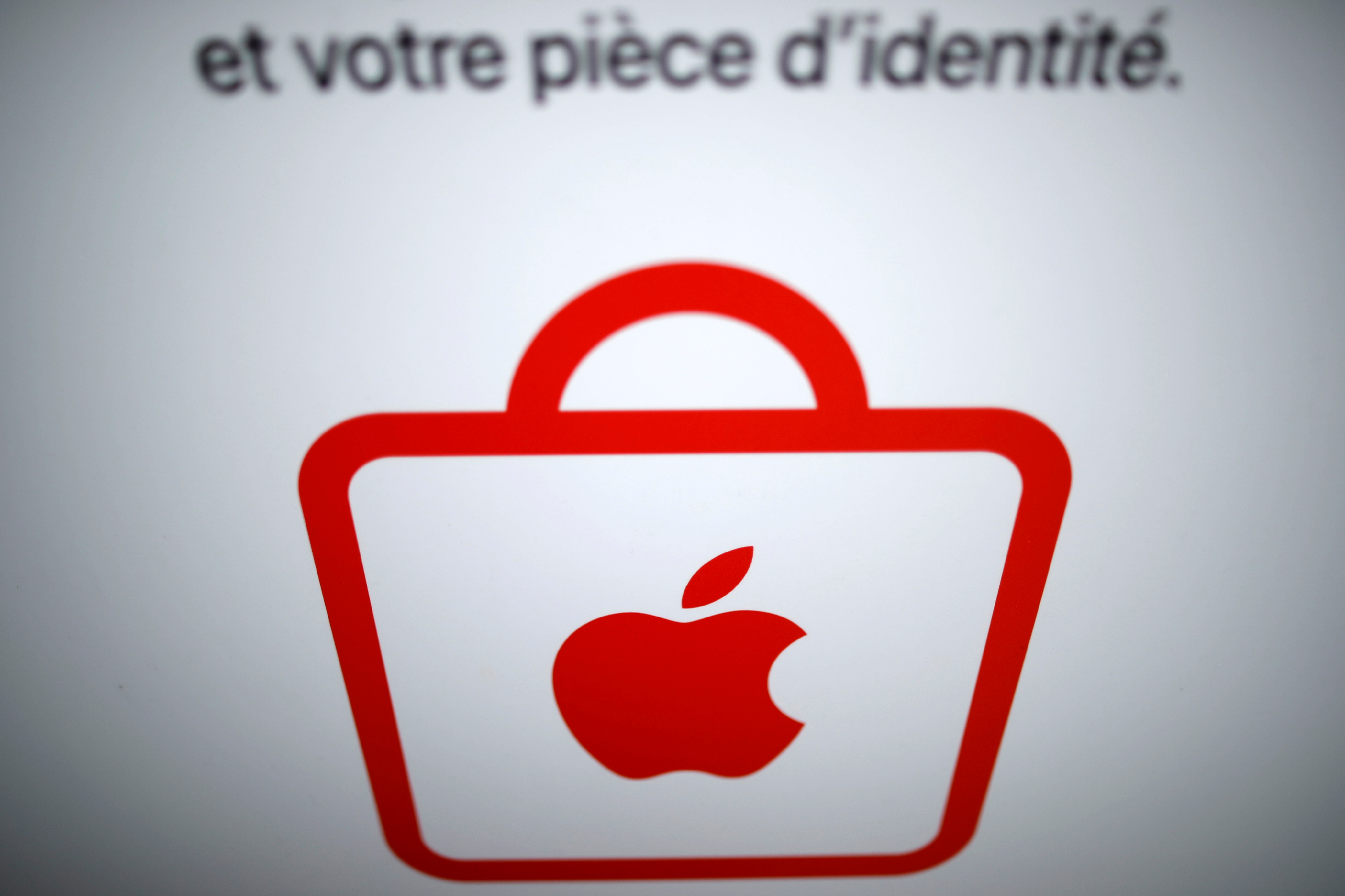 Apple logo is seen on an Apple store in Paris, France, March 17, 2021. REUTERS/Gonzalo Fuentes