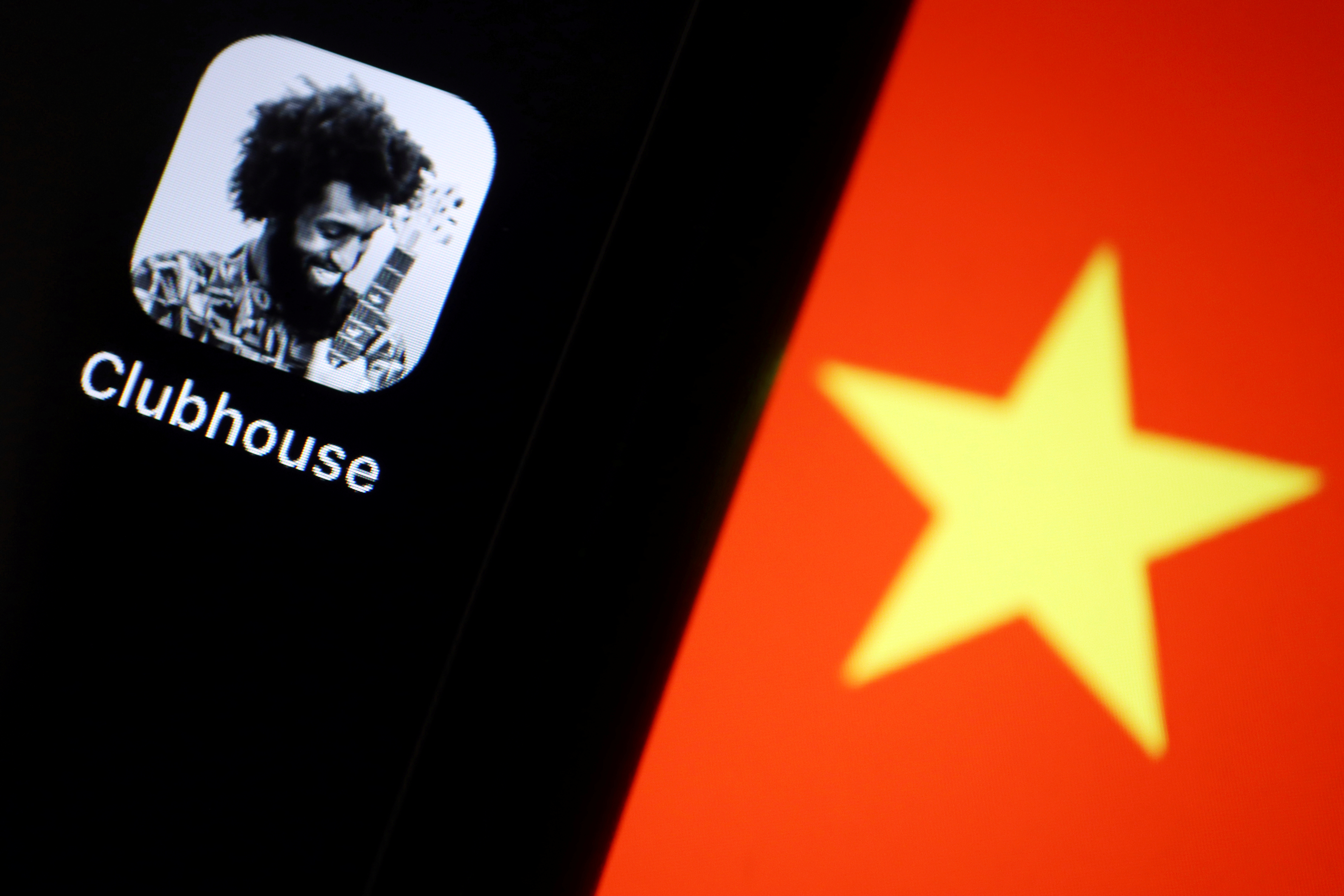 The social audio app Clubhouse is pictured near a star on the Chinese flag in this illustration picture taken February 8, 2021. REUTERS/Florence Lo/Illustration/File Photo