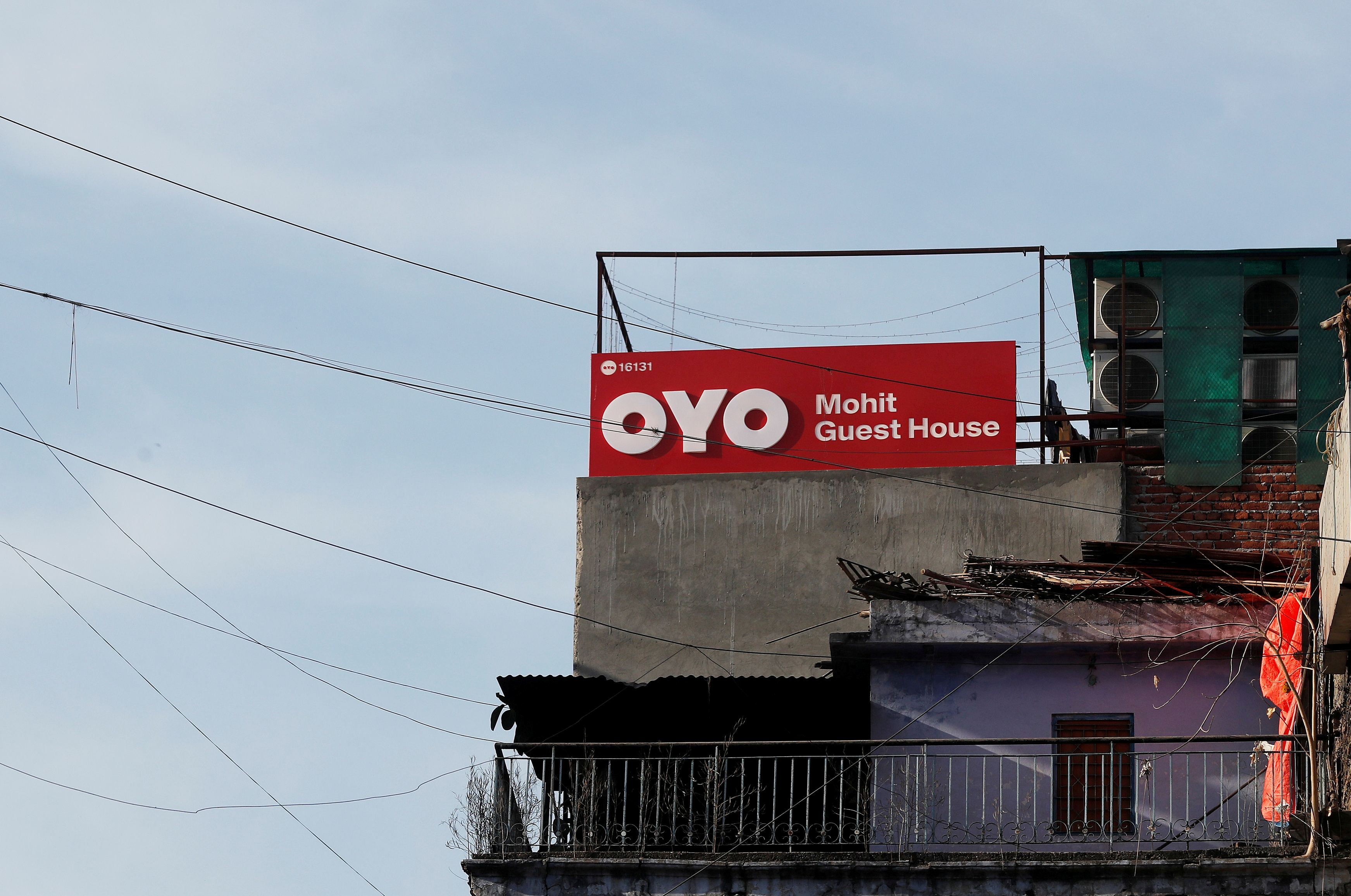The logo of OYO, India's largest and fastest-growing hotel chain, is seen installed on a hotel building in New Delhi, India, April 3, 2019. REUTERS/Adnan Abidi/File Photo