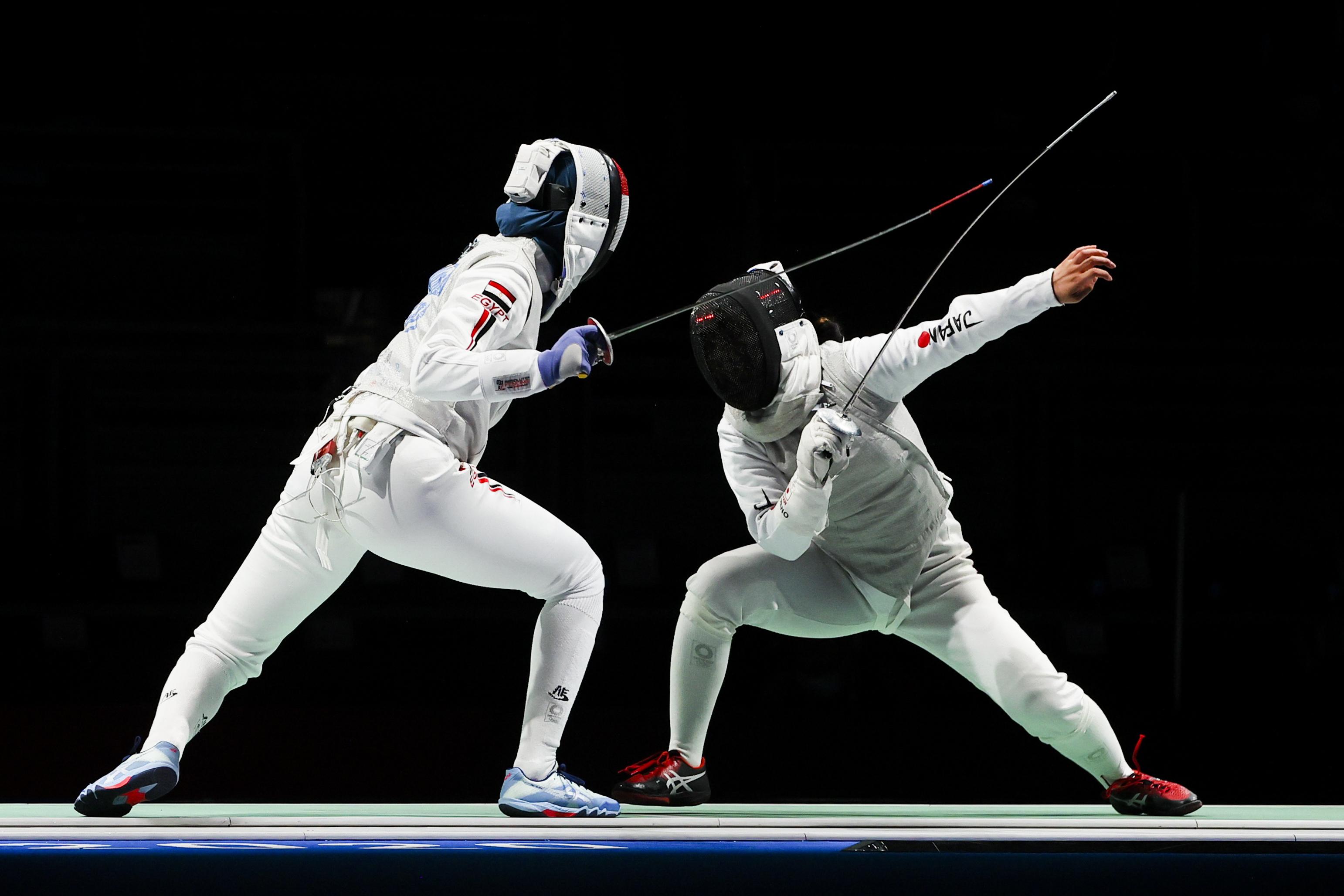 Tokyo 2020 Olympics - Fencing - Women's Individual Foil - Last 32 - Makuhari Messe Hall B - Chiba, Japan - July 25, 2021. Nora Mohamed of Egypt in action against Yuka Ueno of Japan REUTERS/Maxim Shemetov