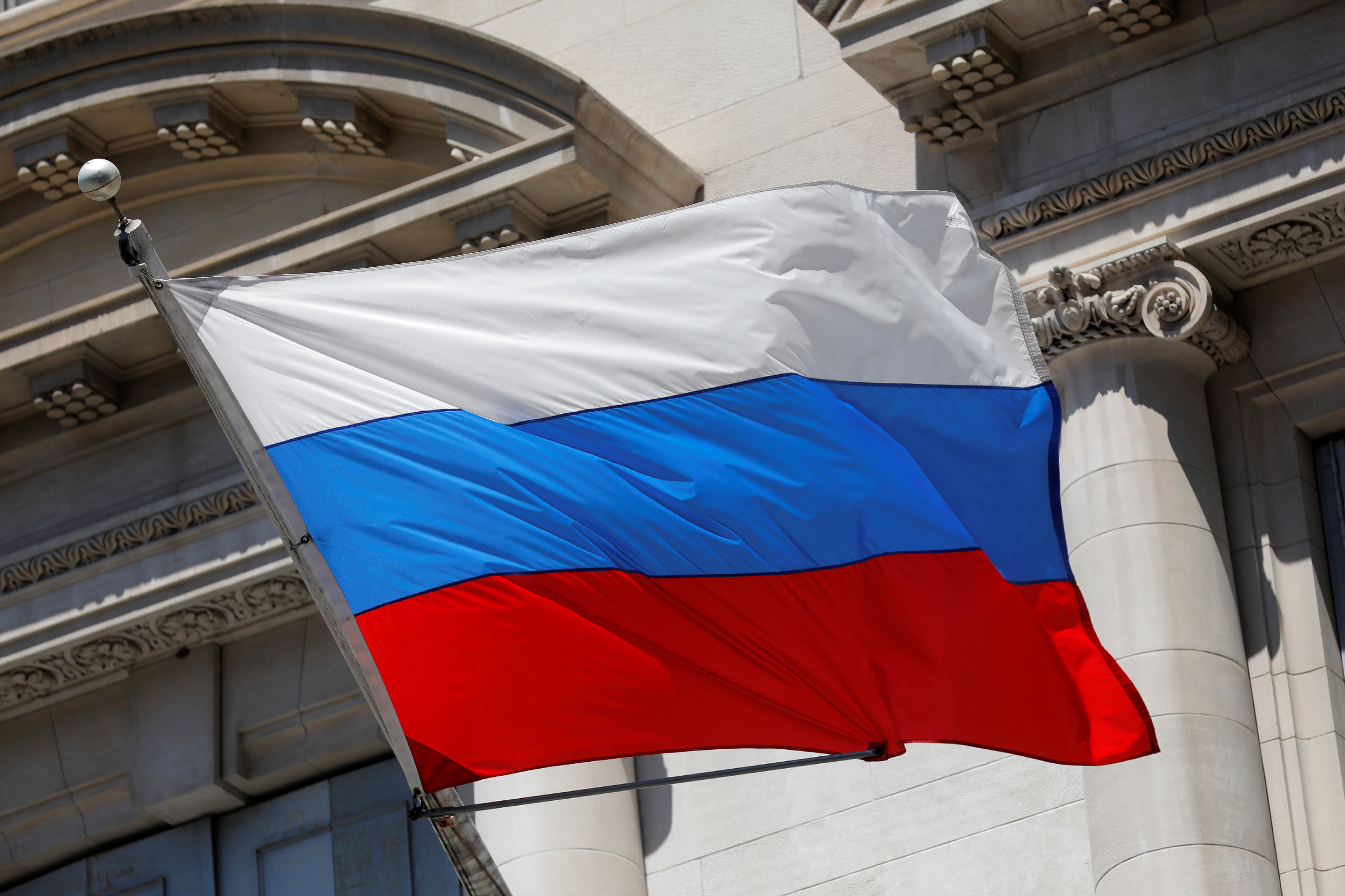 A Russian flag flies outside the Consulate General of the Russian Federation in New York after the U.S. introduced a 3-year restriction on the stay of Russian Diplomats and gave a list of 24 employees of the diplomatic mission who will need to leave the country by September 3, 2021 in Manhattan, New York City, U.S., August 2, 2021. REUTERS/Andrew Kelly
