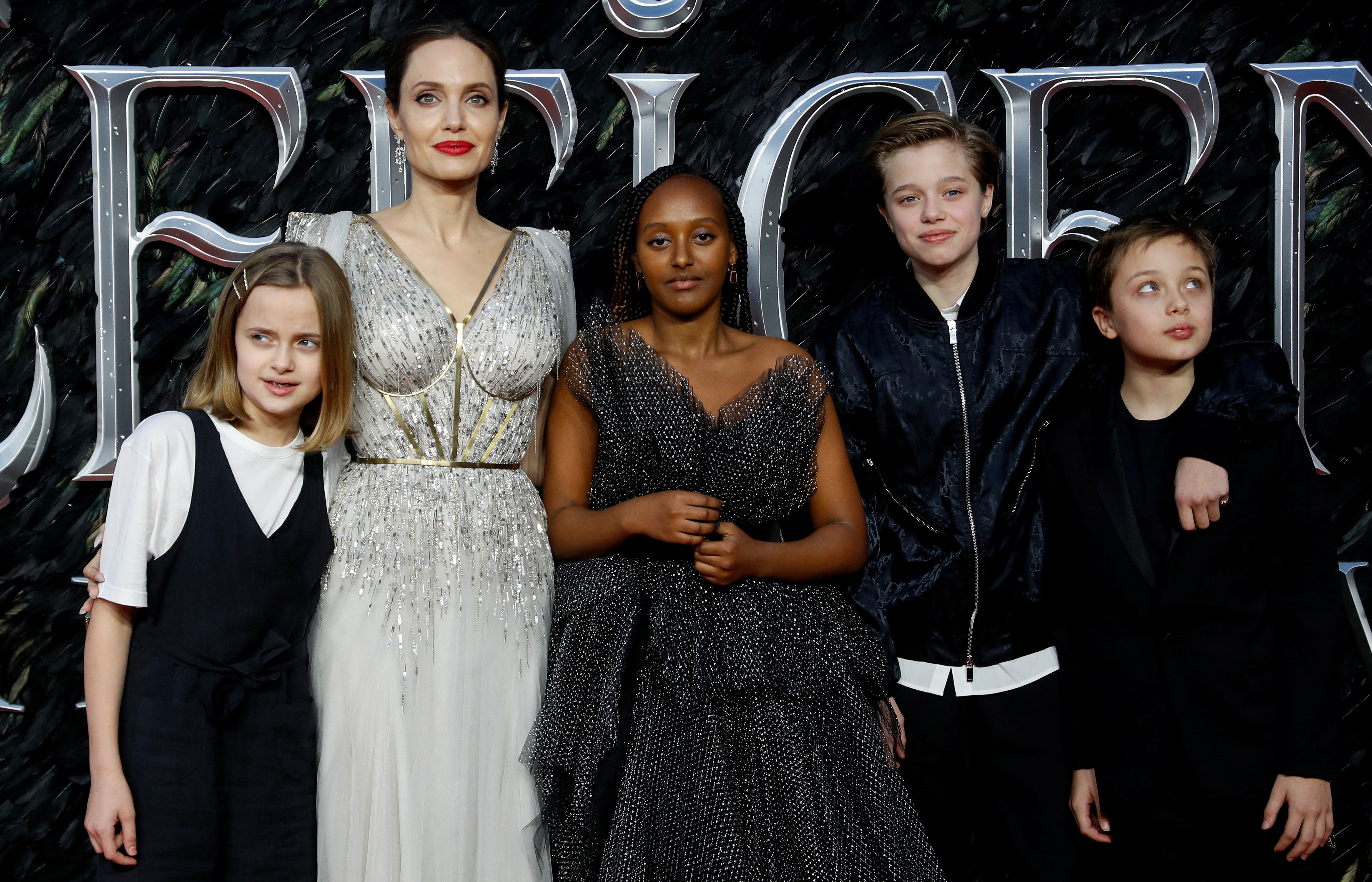 Actor Angelina Jolie, accompanied by her children, poses as she attends the UK premiere of