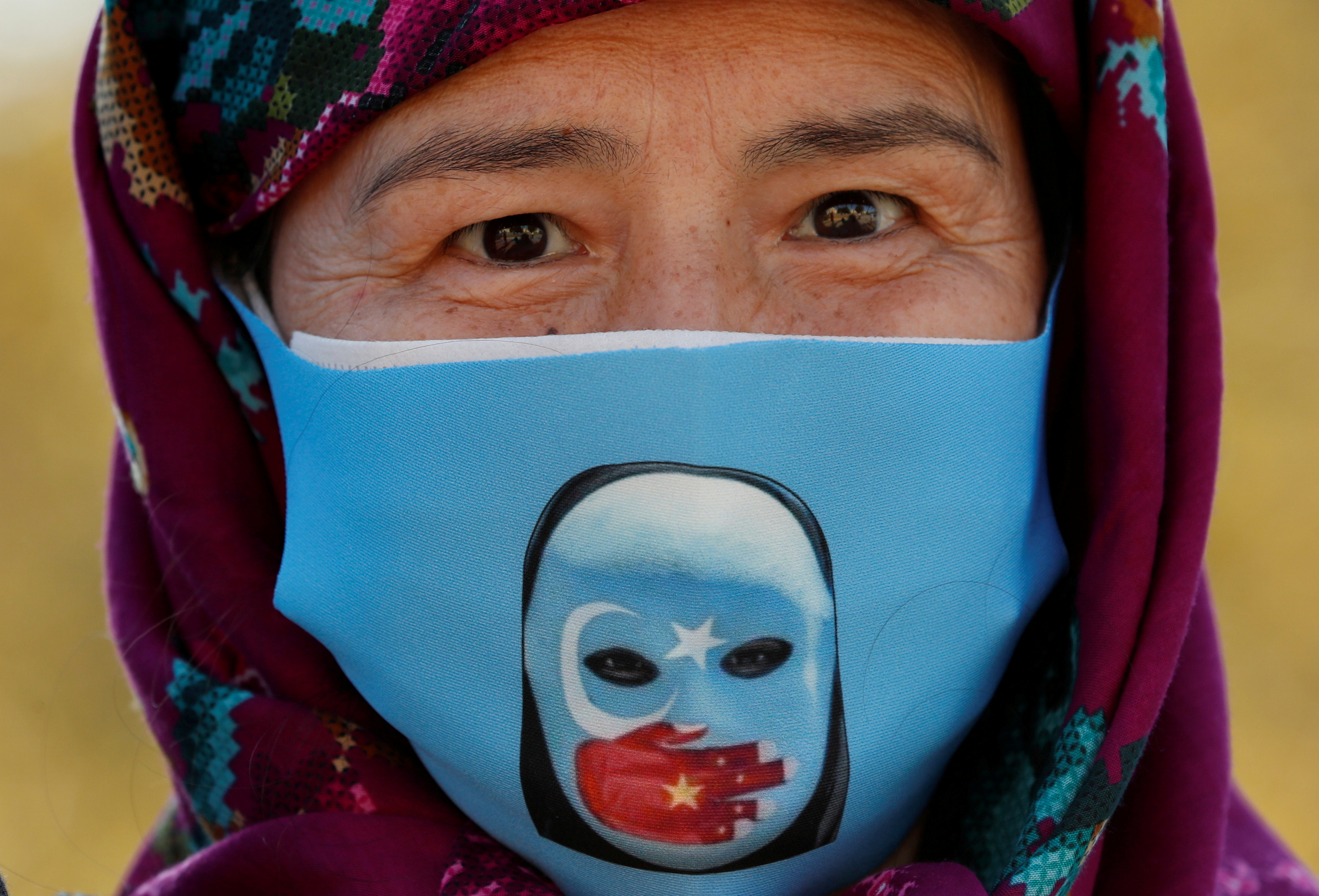 An Ethnic Uighur demonstrator wearing a protective face mask takes part in a protest against China, in Istanbul, Turkey October 1, 2020. REUTERS/Murad Sezer