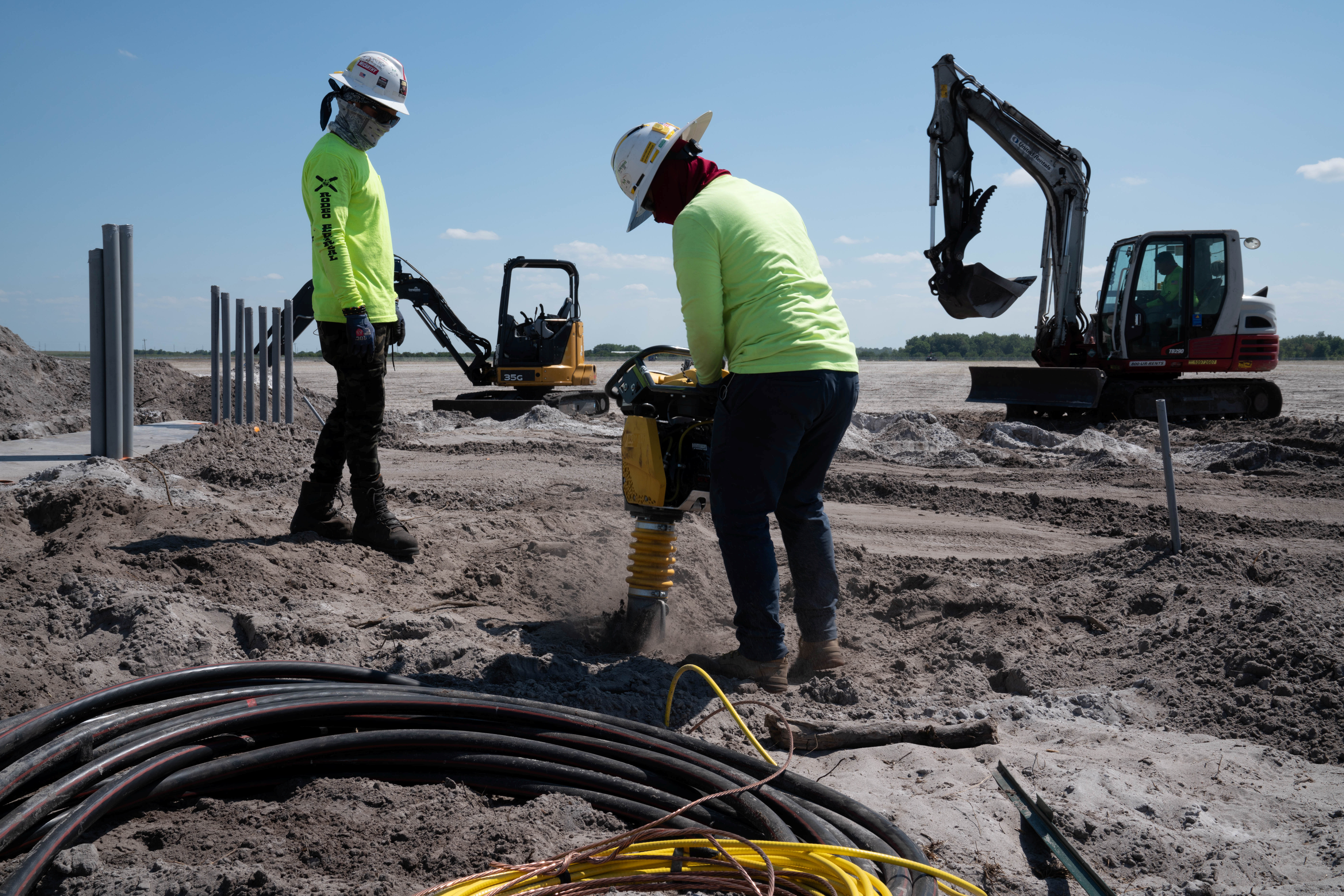 Workers prepare the ground for construction at the Duette solar site which is being developed on previously agricultural land in Bowling Green, Florida, U.S., March 24, 2021. REUTERS/Dane Rhys