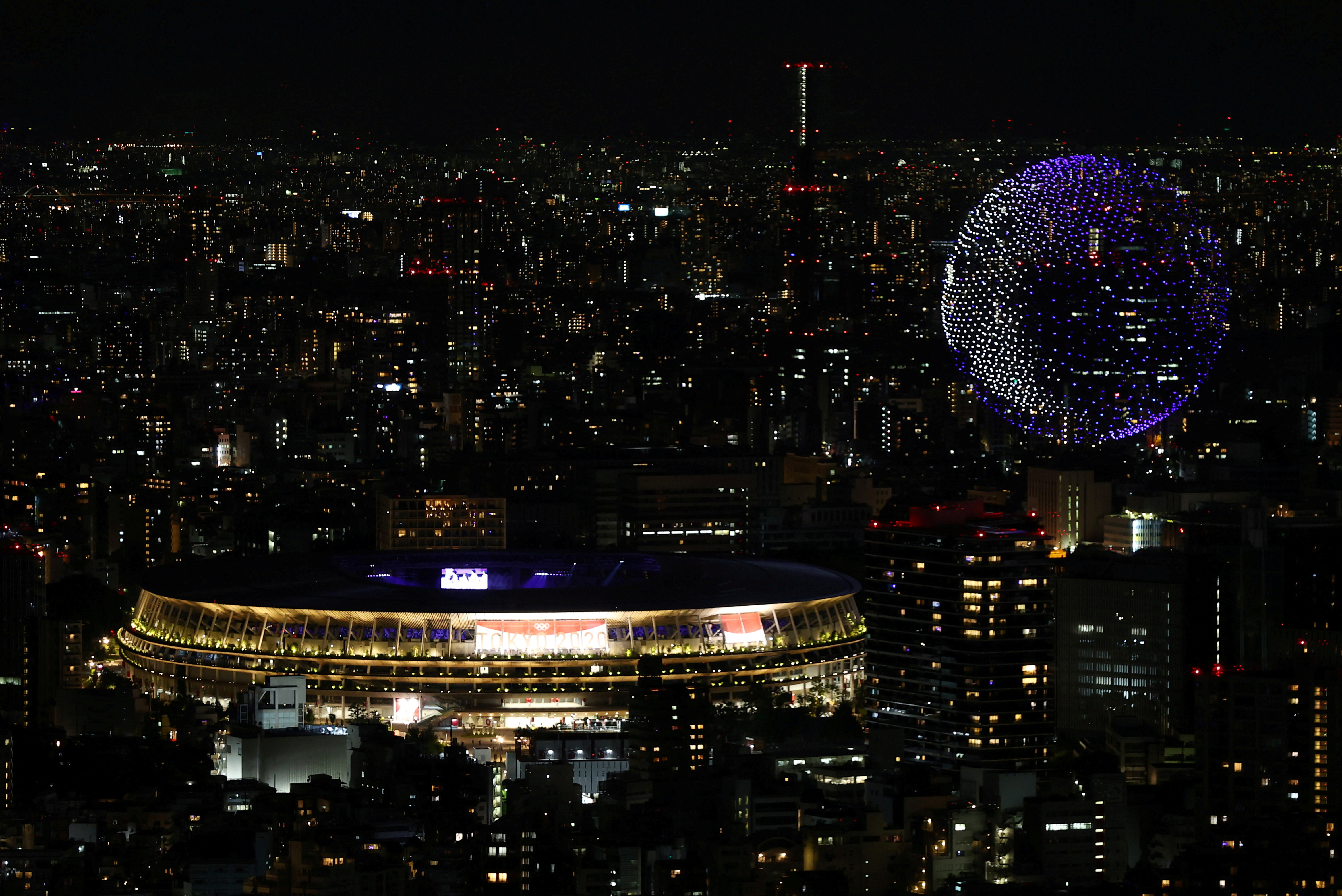The Tokyo 2020 Olympics Opening Ceremony - Olympic Stadium, Tokyo, Japan - July 23, 2021. Drones form a shape of the world during the opening ceremony, seen above the Olympic Stadium REUTERS/Kim Kyung-Hoon/File Photo
