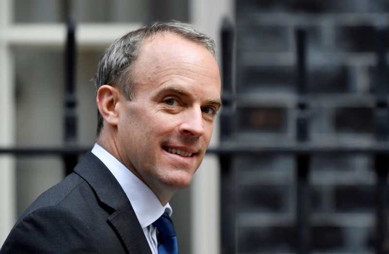 Britain's Foreign Affairs Secretary Dominic Raab walks outside Downing Street in London, Britain, September 22, 2020. REUTERS/Toby Melville/File Photo