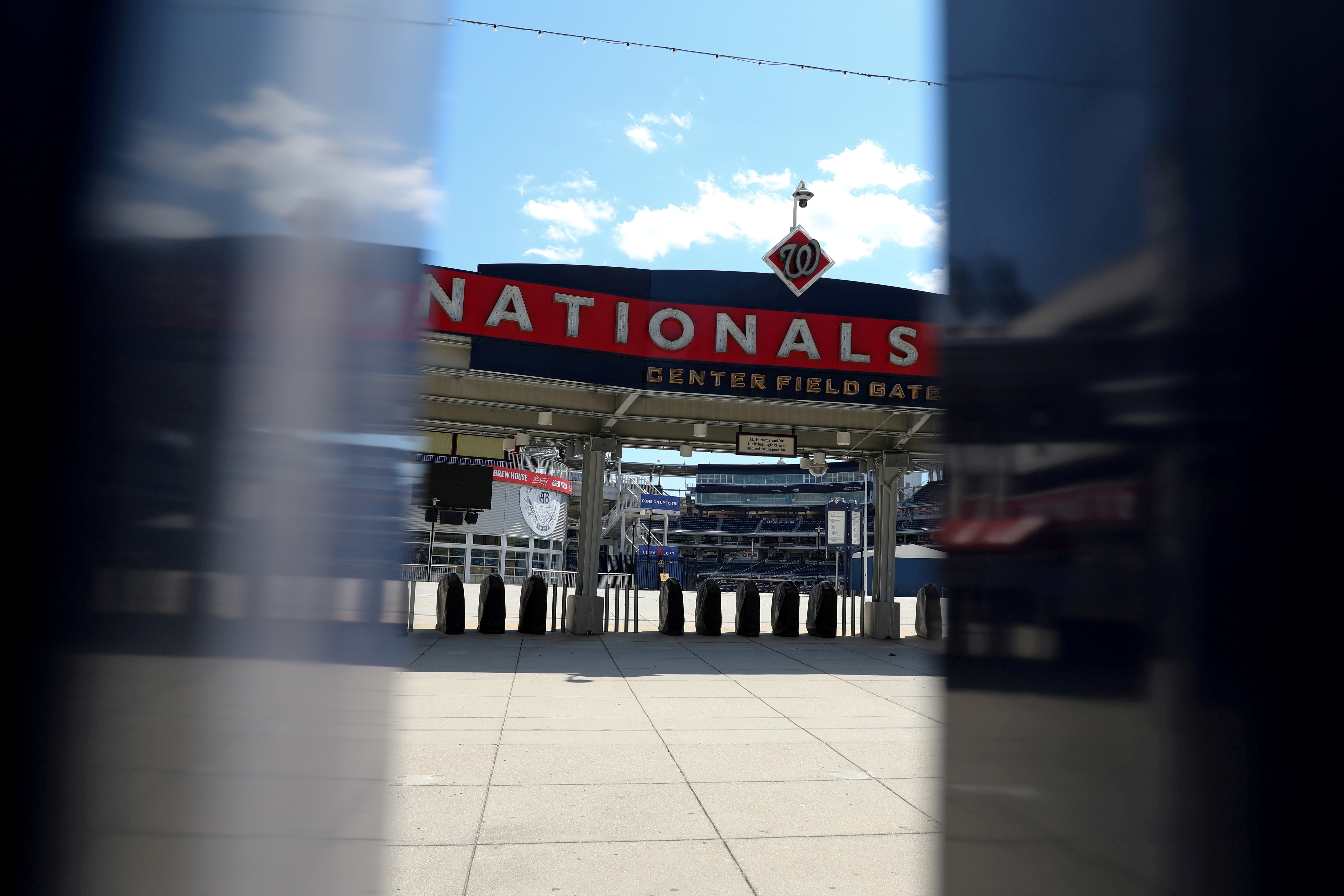 The empty turnstiles at Nationals Park, home of Major League Baseball's Washington Nationals, are seen on May 13, 2020. REUTERS/Jonathan Ernst