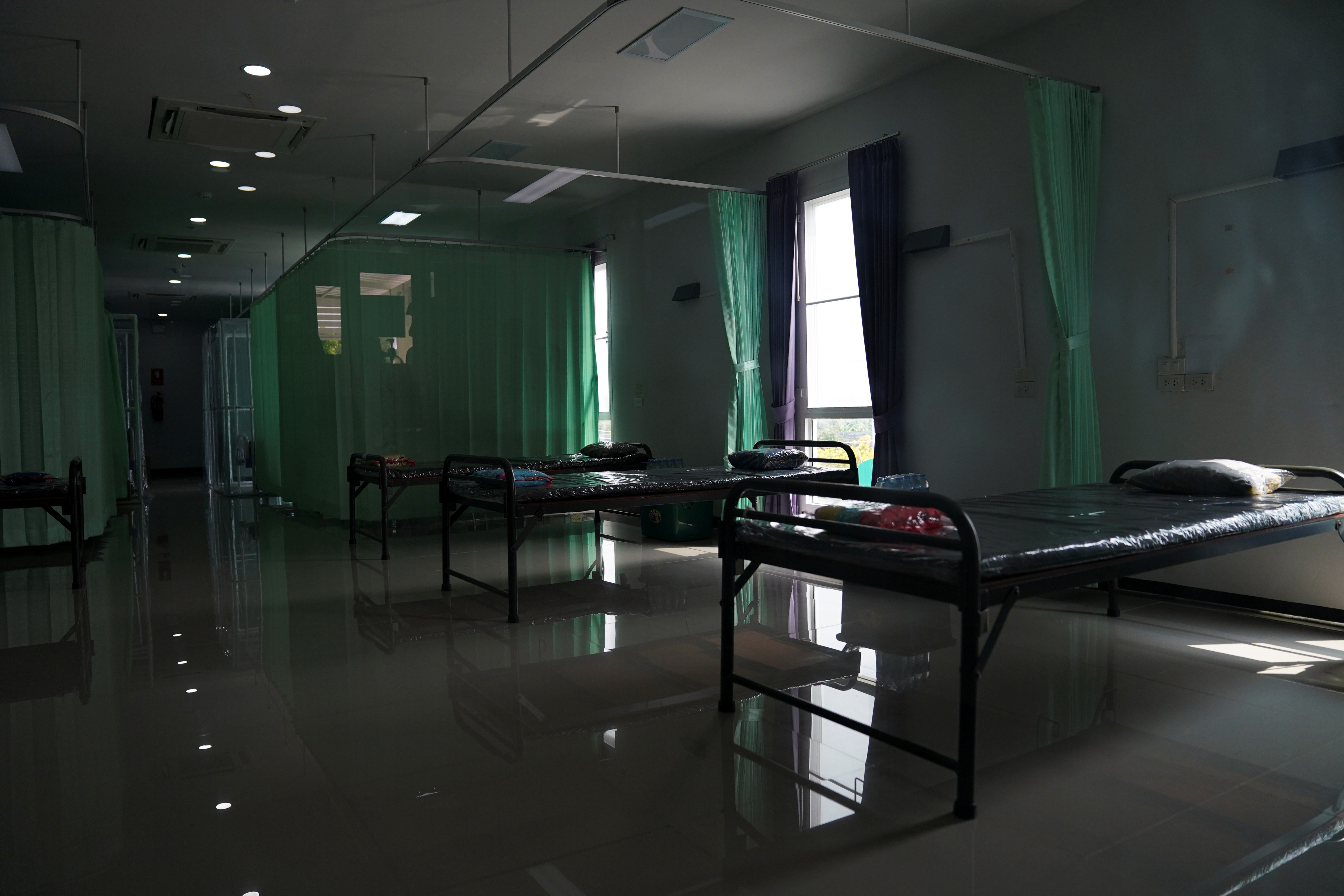 Empty beds are seen inside a field hospital recently set up to fight the spread of the coronavirus disease (COVID-19) as the country deals with a fresh wave of infections after tackling earlier outbreaks, in Bangkok, Thailand, April 10, 2021. REUTERS/Athit Perawongmetha