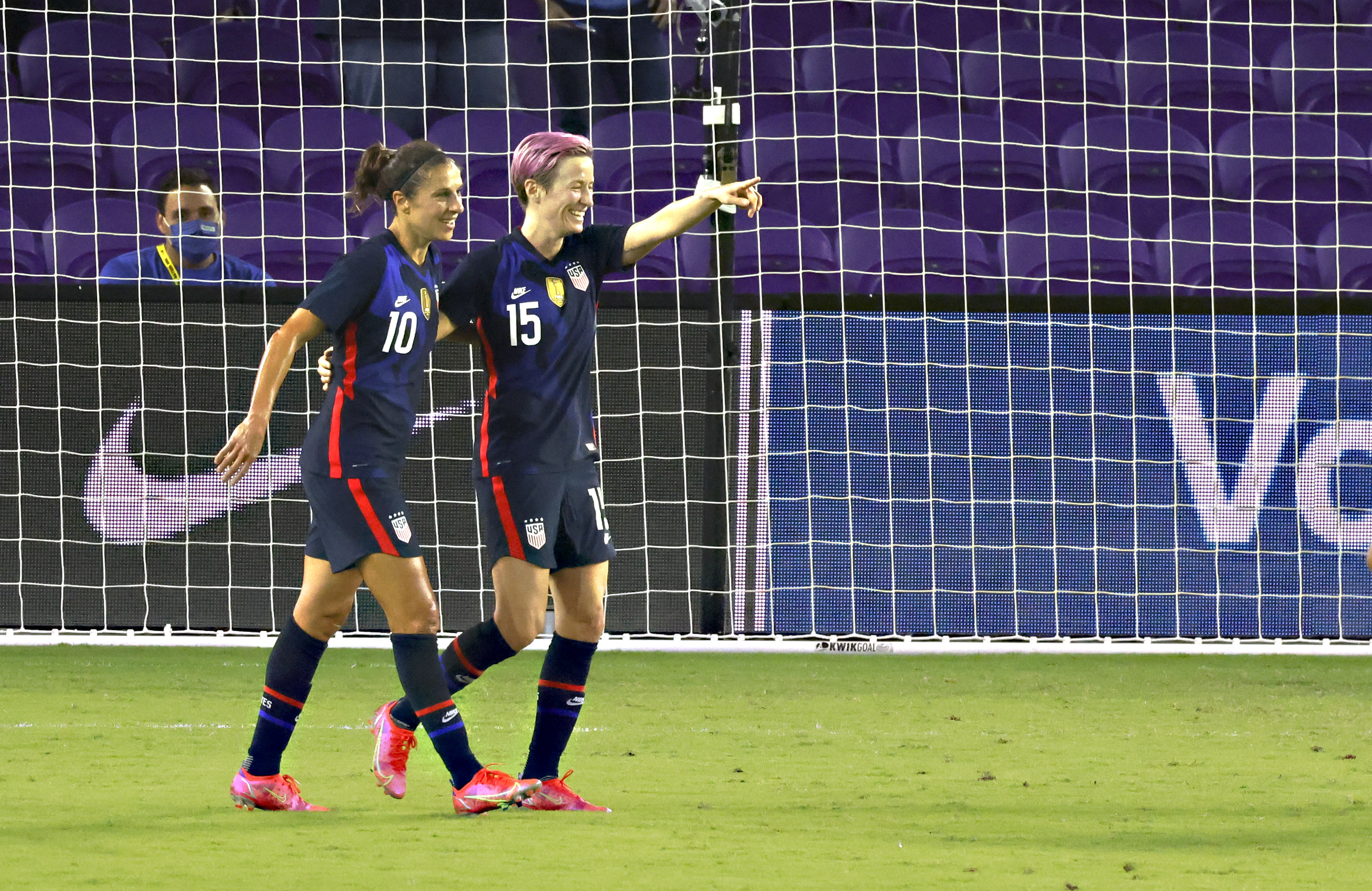 Feb 24, 2021; Orlando, Florida, USA; United States midfielder Carli Lloyd (10) celebrates a goal by forward Megan Rapinoe (15) during the first half of a She Believes Cup soccer match against Argentina at Exploria Stadium. Mandatory Credit: Reinhold Matay-USA TODAY Sports