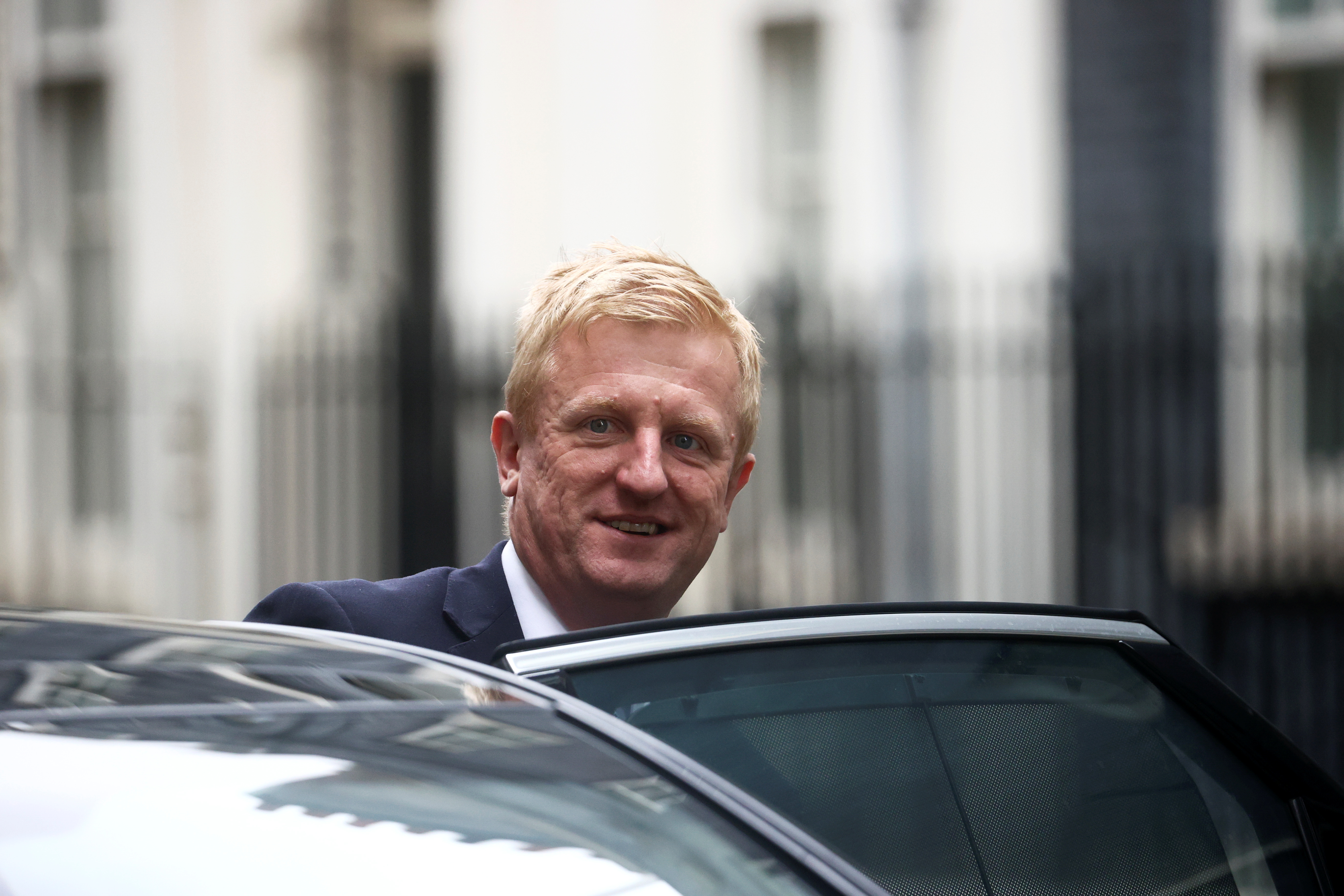 Britain's Secretary of State for Digital, Culture, Media and Sport Oliver Dowden gets into a car outside Downing Street in London, Britain, September 15, 2021. REUTERS/Hannah McKay/File Photo