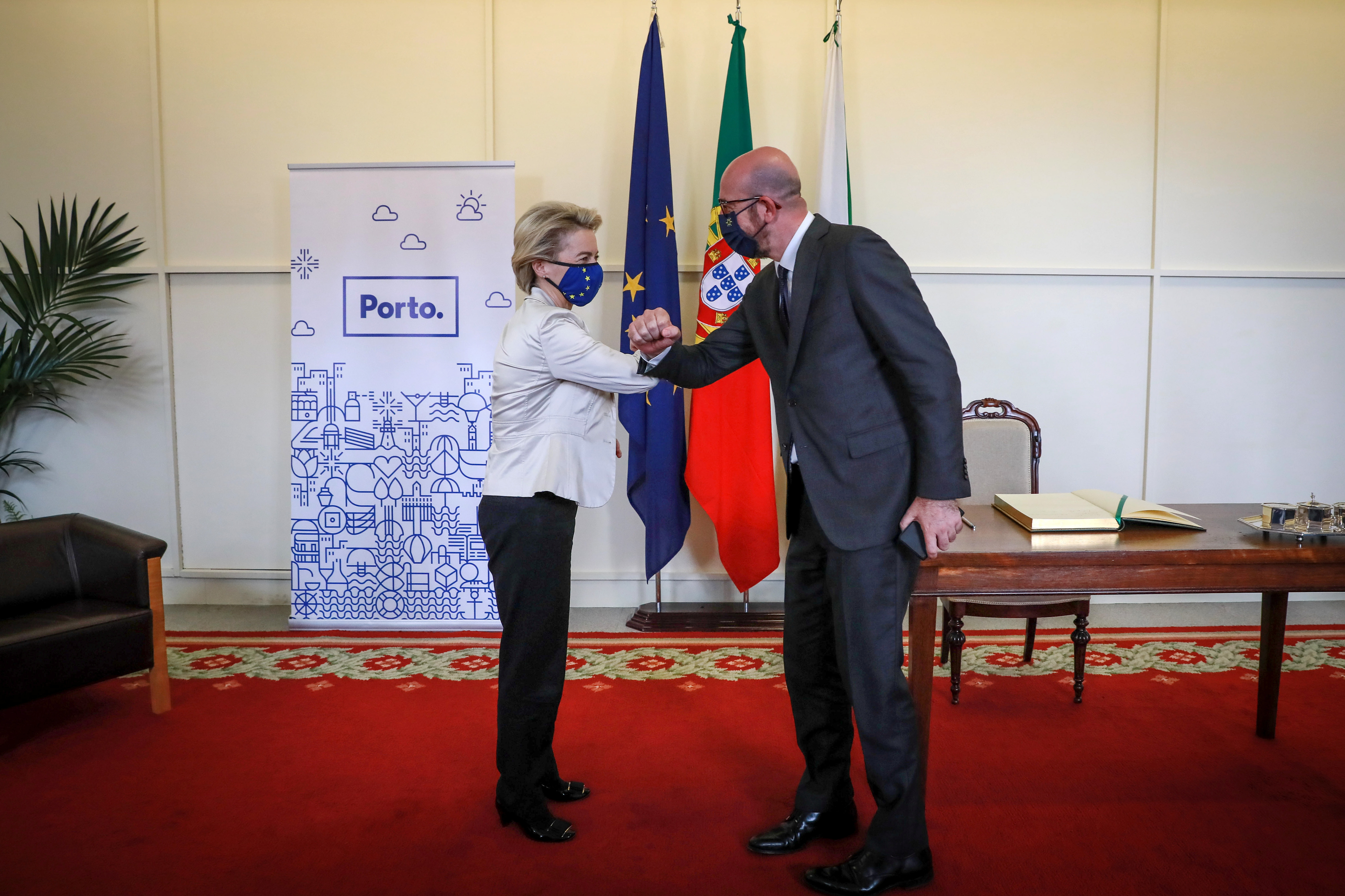 President of the European Council Charles Michel and President of the European Commission Ursula Von der Leyen greet each other during the ceremony to present the keys to the city of Porto at Porto City hall, Portugal, May 7, 2021. Estela Silva/Pool via REUTERS