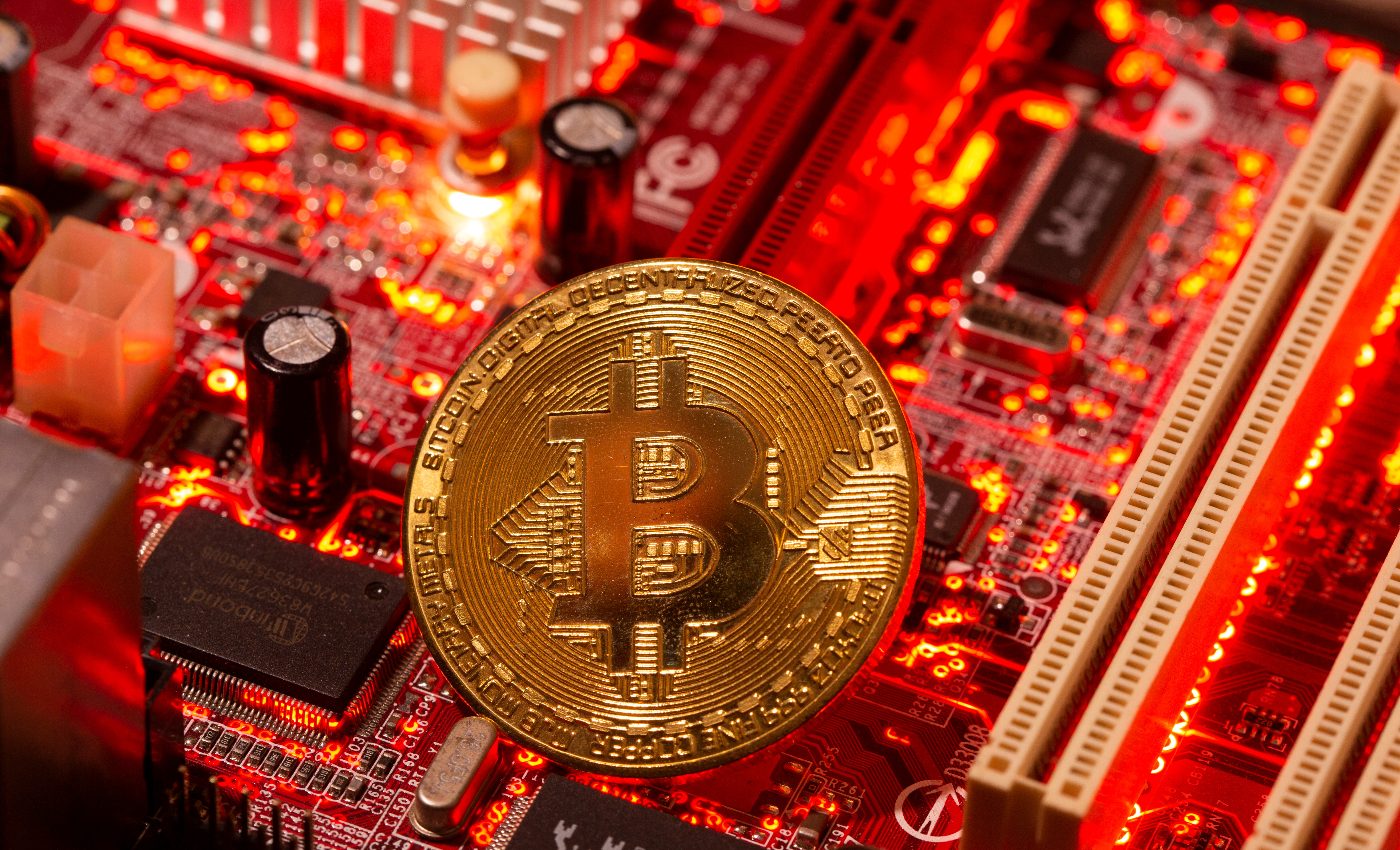 A representation of virtual currency Bitcoin is placed on a computer motherboard in this illustration taken January 21, 2021. REUTERS/Dado Ruvic/Illustration