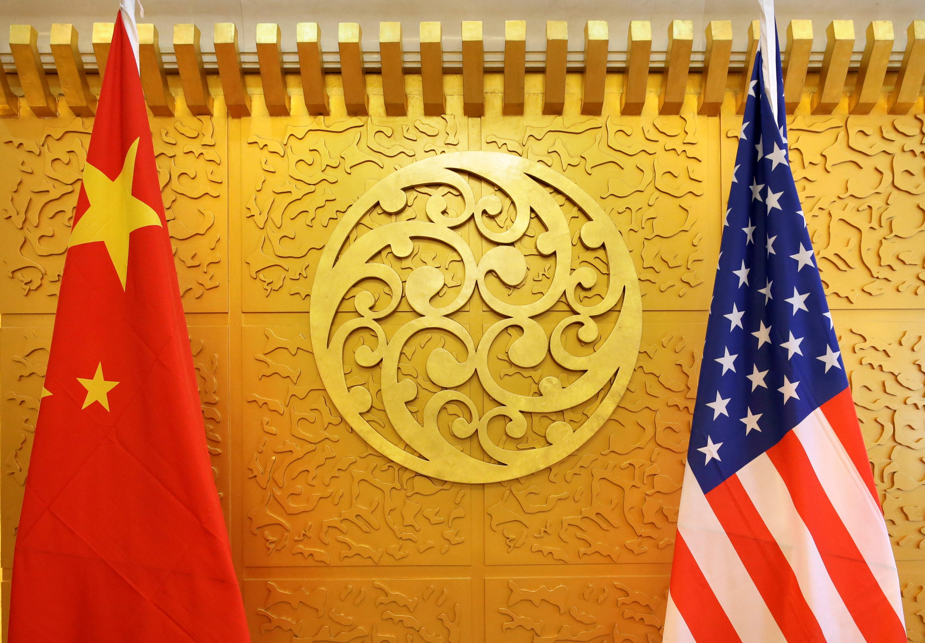 Chinese and U.S. flags are set up for a meeting at China's Ministry of Transport in Beijing, China April 27, 2018. REUTERS/Jason Lee/File Photo