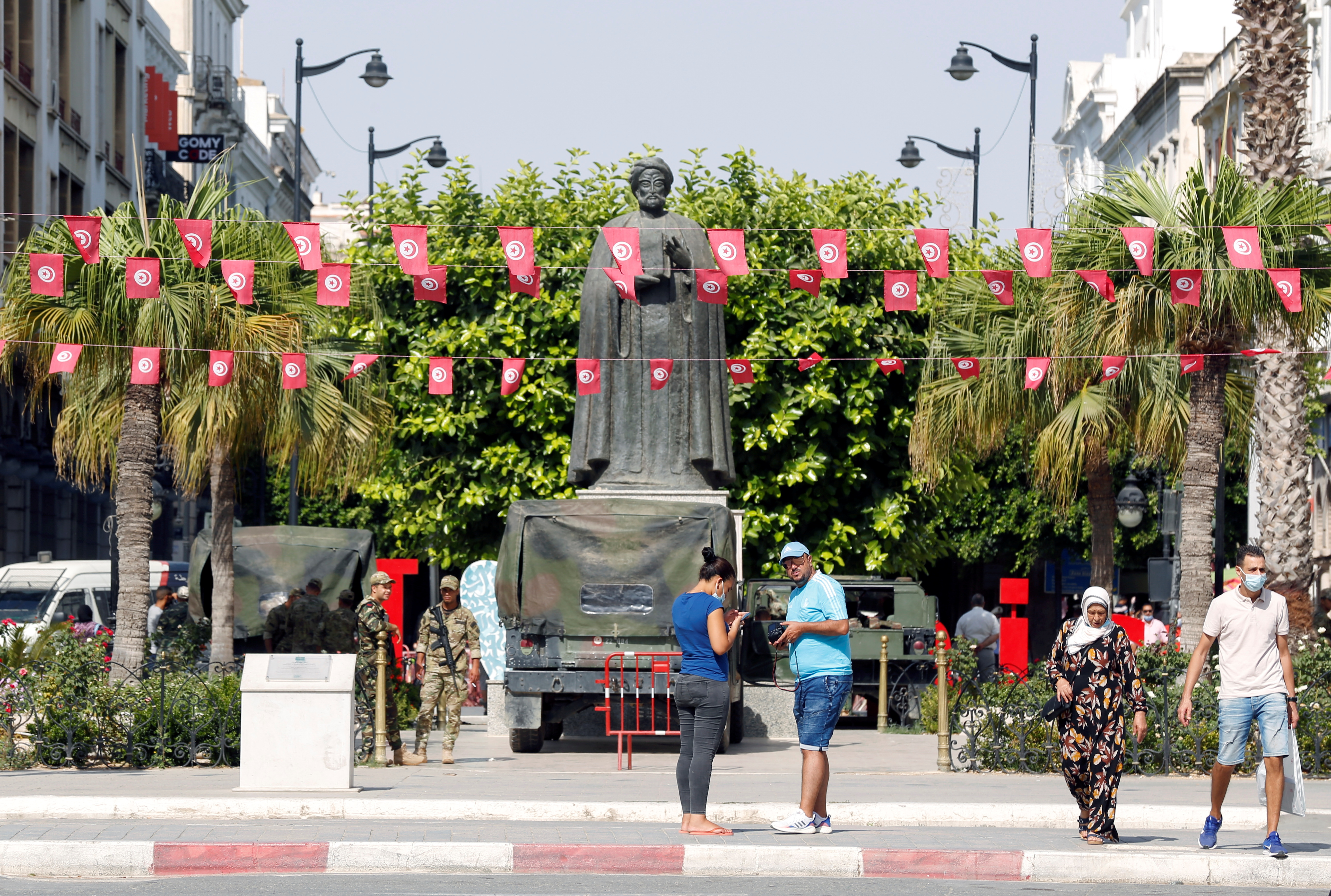 People walk in the center of Tunis, Tunisia, July 28, 2021.  REUTERS/Zoubeir Souissi