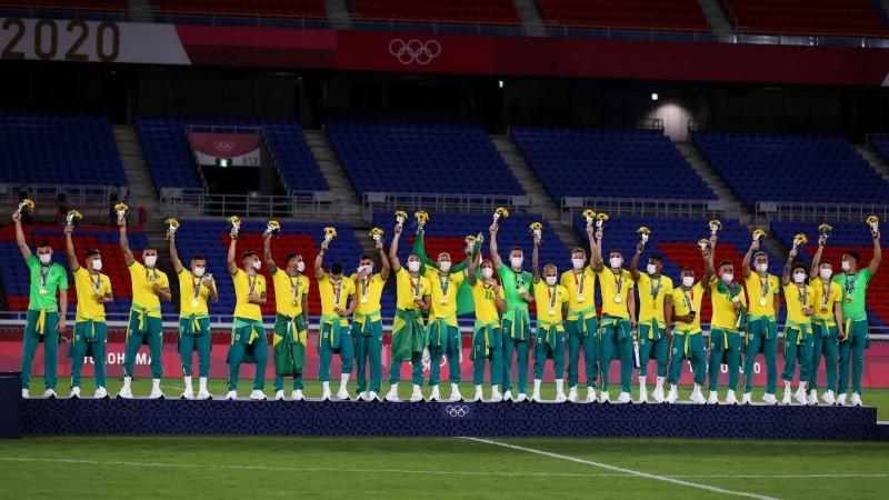Tokyo 2020 Olympics - Soccer Football - Men's Team - Medal Ceremony - International Stadium Yokohama, Yokohama, Japan - August 7, 2021. Gold medallists Brazil celebrate during the medal ceremony. REUTERS/Amr Abdallah Dalsh/File Photo