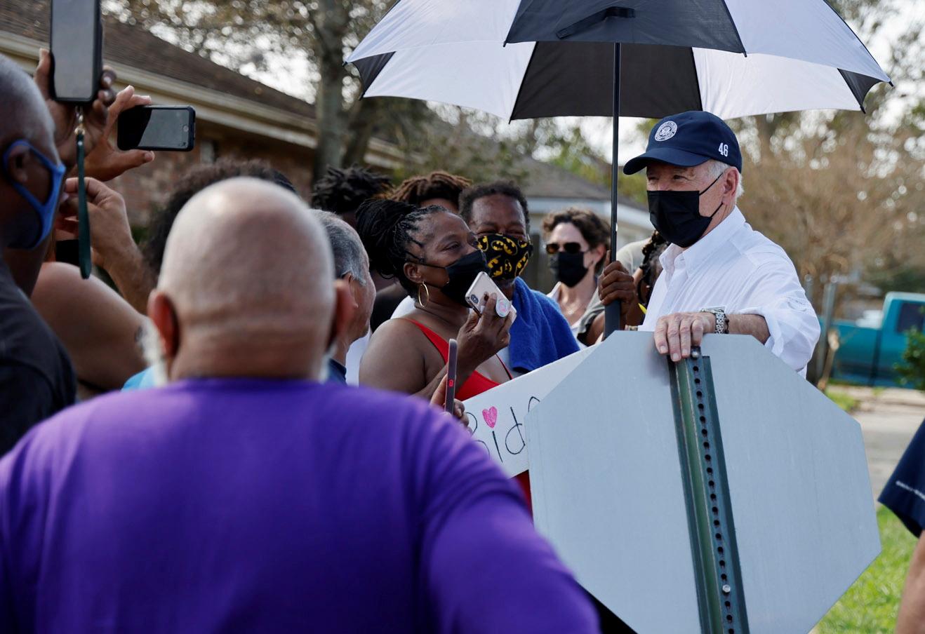 U.S. President Joe Biden talks to residents as he tours a neighbourhood hit by Hurricane Ida in LaPlace, Louisiana, U.S. September 3, 2021. REUTERS/Jonathan Ernst