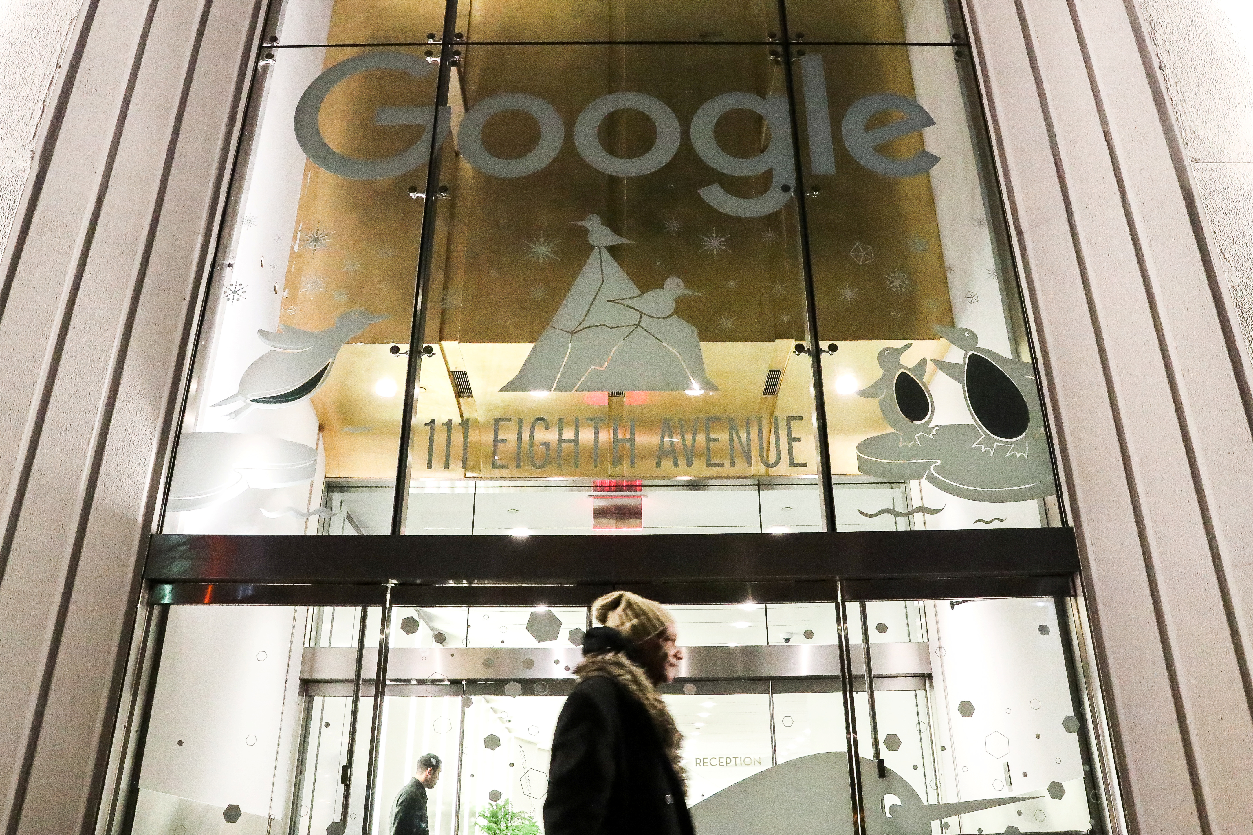 A pedestrian walks past Google headquarters in the Manhattan borough of New York City, New York, U.S., December 17, 2018. REUTERS/Jeenah Moon
