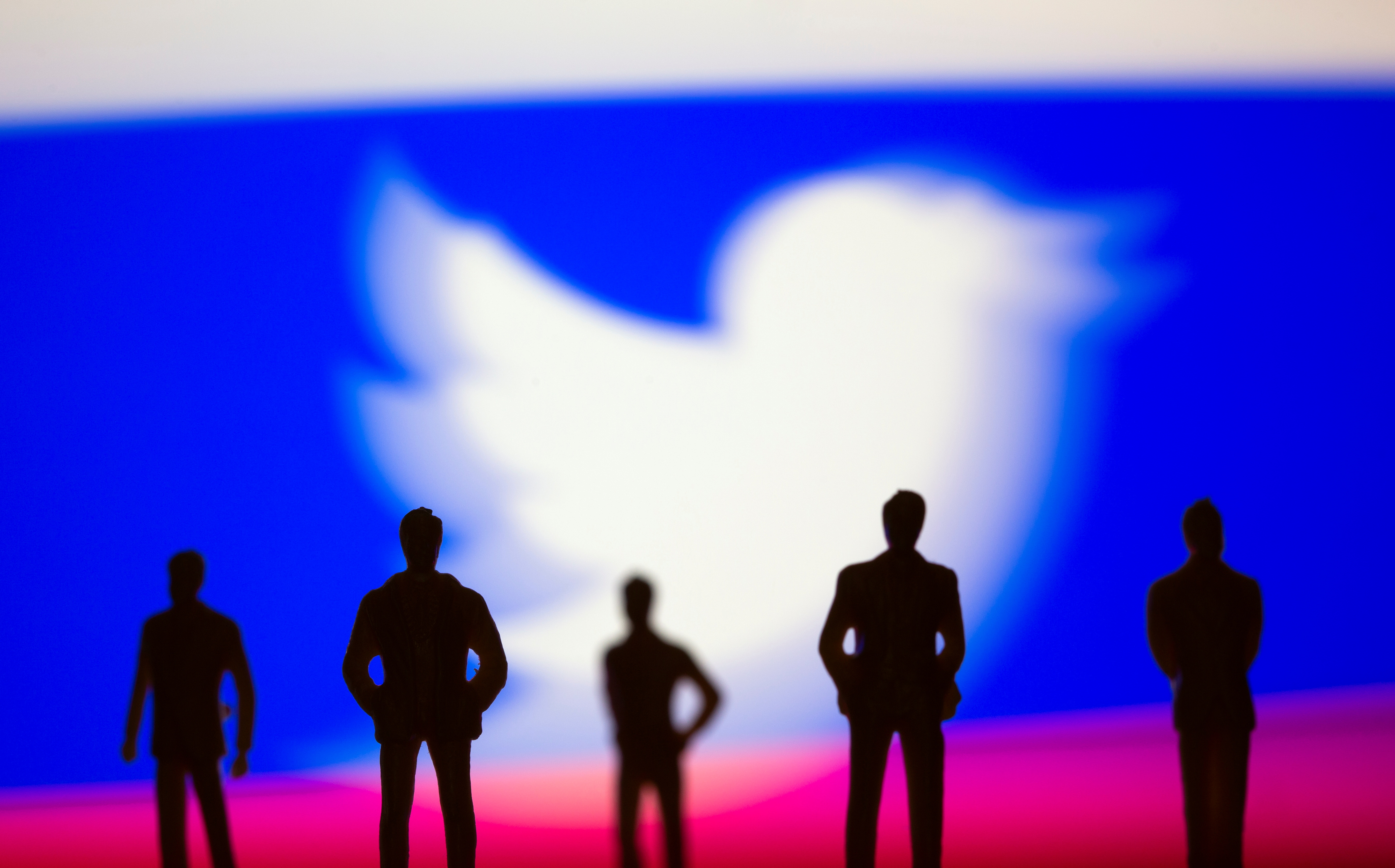 Small toy figures are seen in front of Twitter logo and Russian flag colours in this illustration picture taken March 15, 2021. REUTERS/Dado Ruvic/Illustration/File Photo