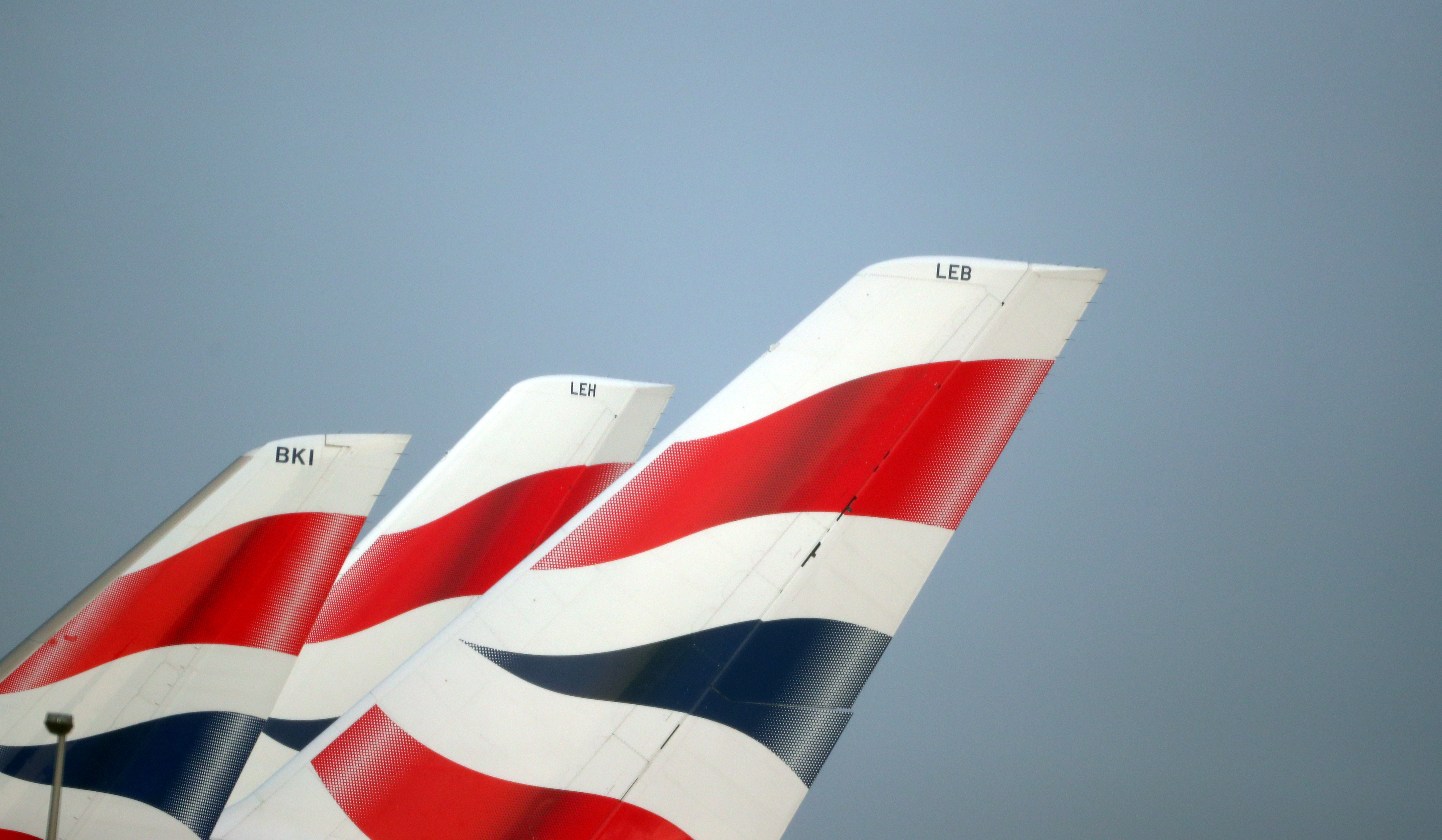 British Airways logos are seen on tail fins at Heathrow Airport in west London, Britain, February 23, 2018. REUTERS/Hannah McKay