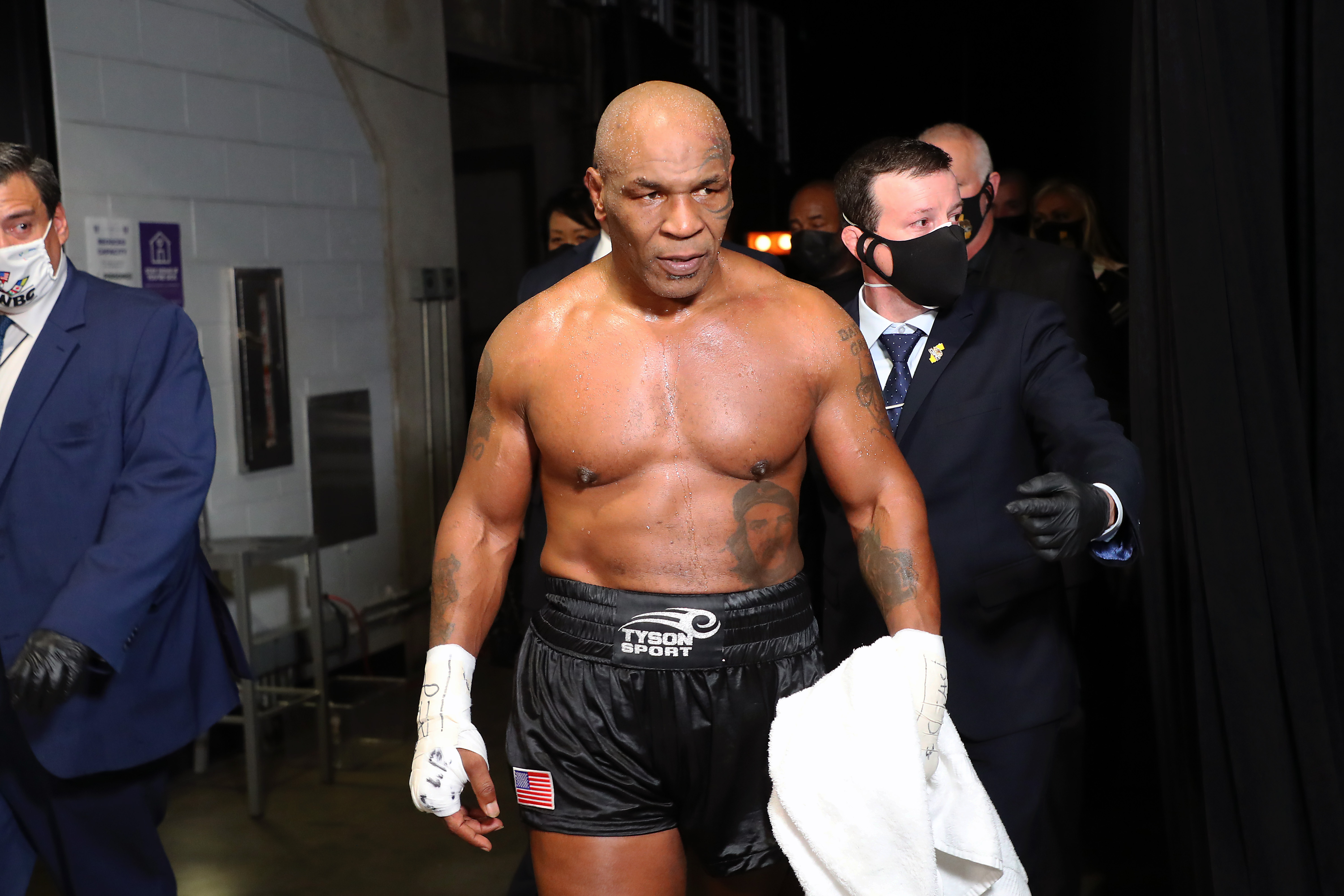Nov 28, 2020; Los Angeles, CA, USA;  Mike Tyson (black trunks) exits the ring after his split draw against Roy Jones, Jr. (white trunks) during a heavyweight exhibition boxing bout for the WBC Frontline Belt at the Staples Center.  Mandatory Credit: Joe Scarnici/Handout Photo via USA TODAY Sports