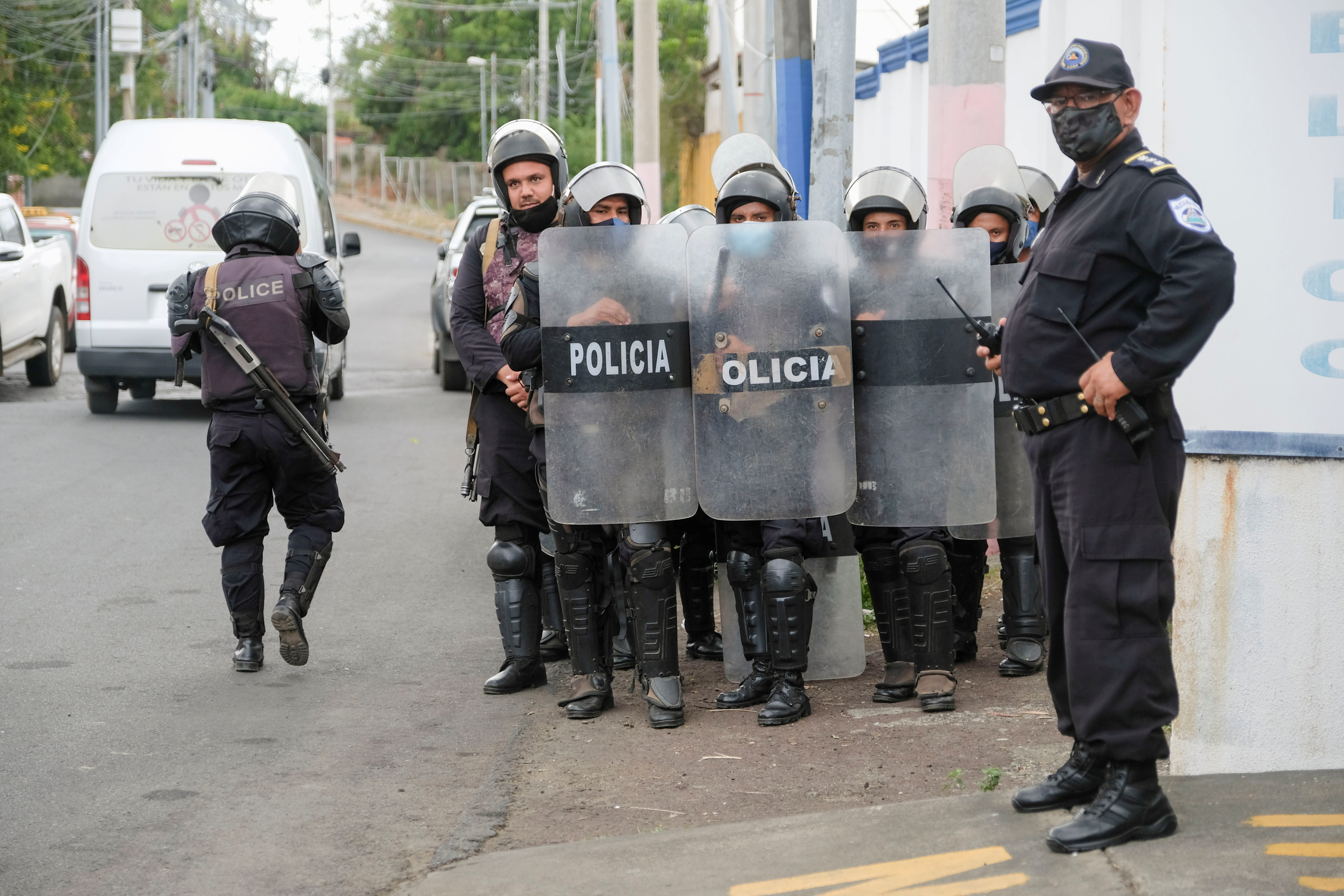 Police officers keep watch outside the Nicaragua Attorney General of the Republic office where Felix Maradiaga, aspiring candidate of the opposition group National Blue and White Unity (UNAB), was summoned by authorities, in Managua, Nicaragua June 8, 2021. REUTERS/Carlos Herrera/File Photo