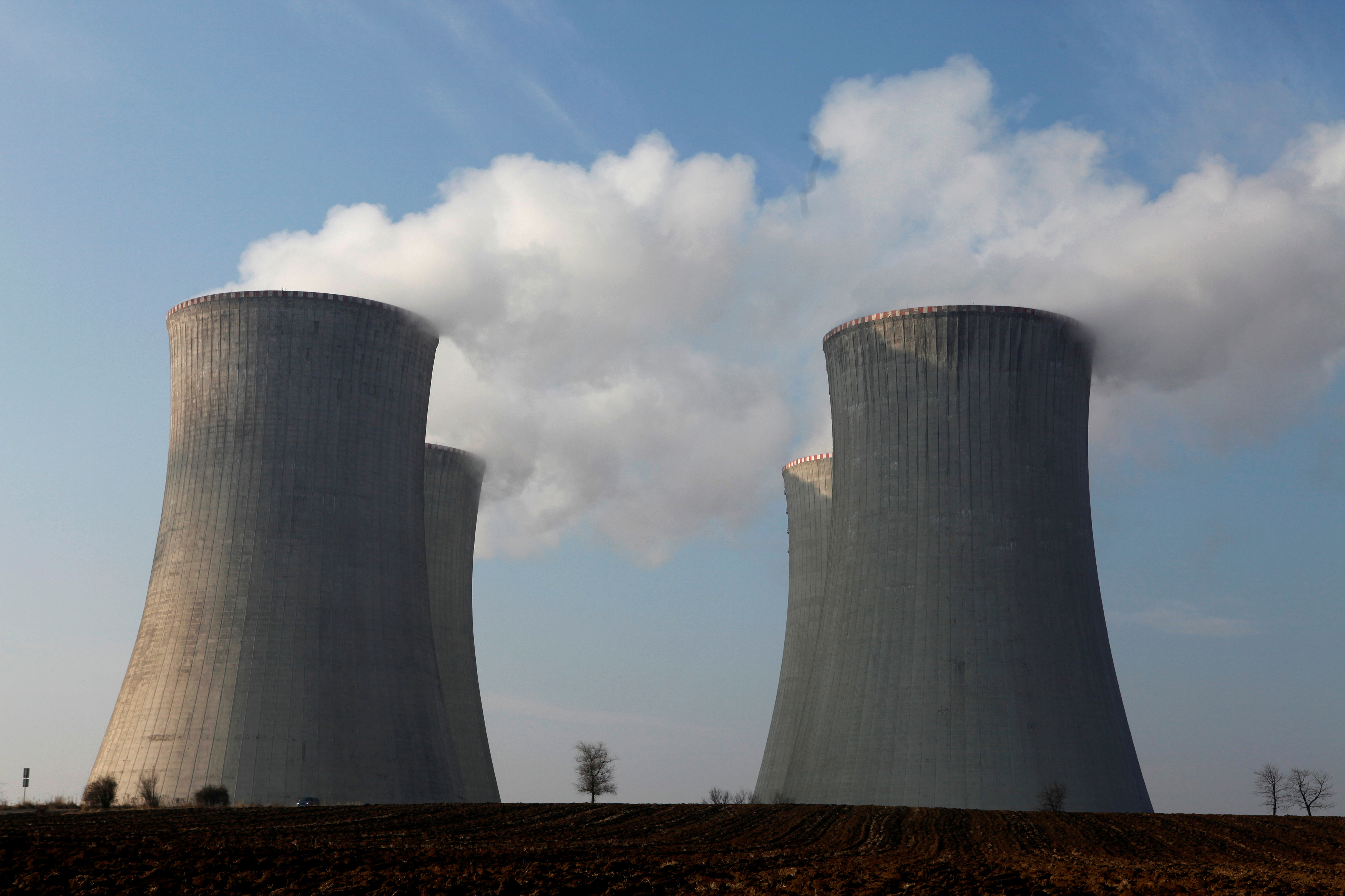 The cooling towers of the Czech nuclear power plant are seen at Dukovany, 125 miles (200 kilometers) east from Prague, March 15, 2011.  REUTERS/Petr Josek/File Photo