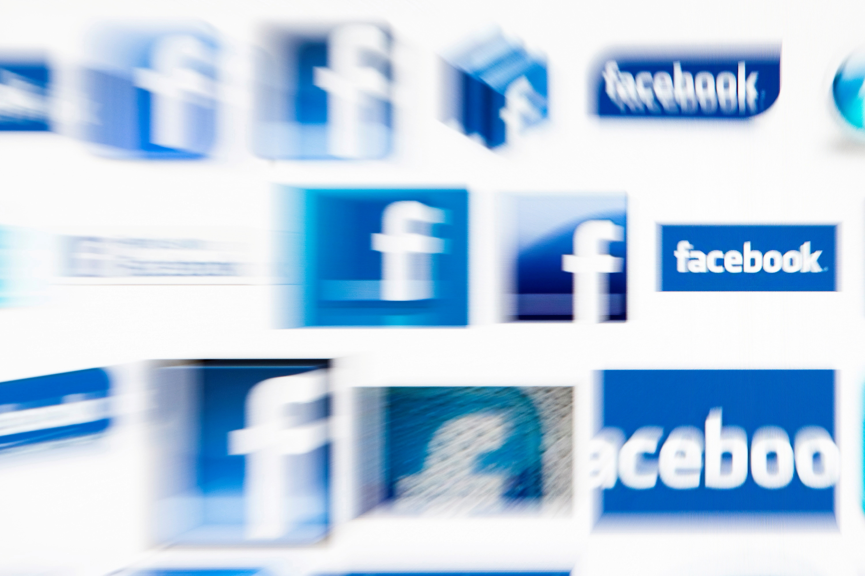 Facebook logos on a computer screen are seen in this photo illustration taken in Lavigny May 16, 2012. REUTERS/Valentin Flauraud/File Photo