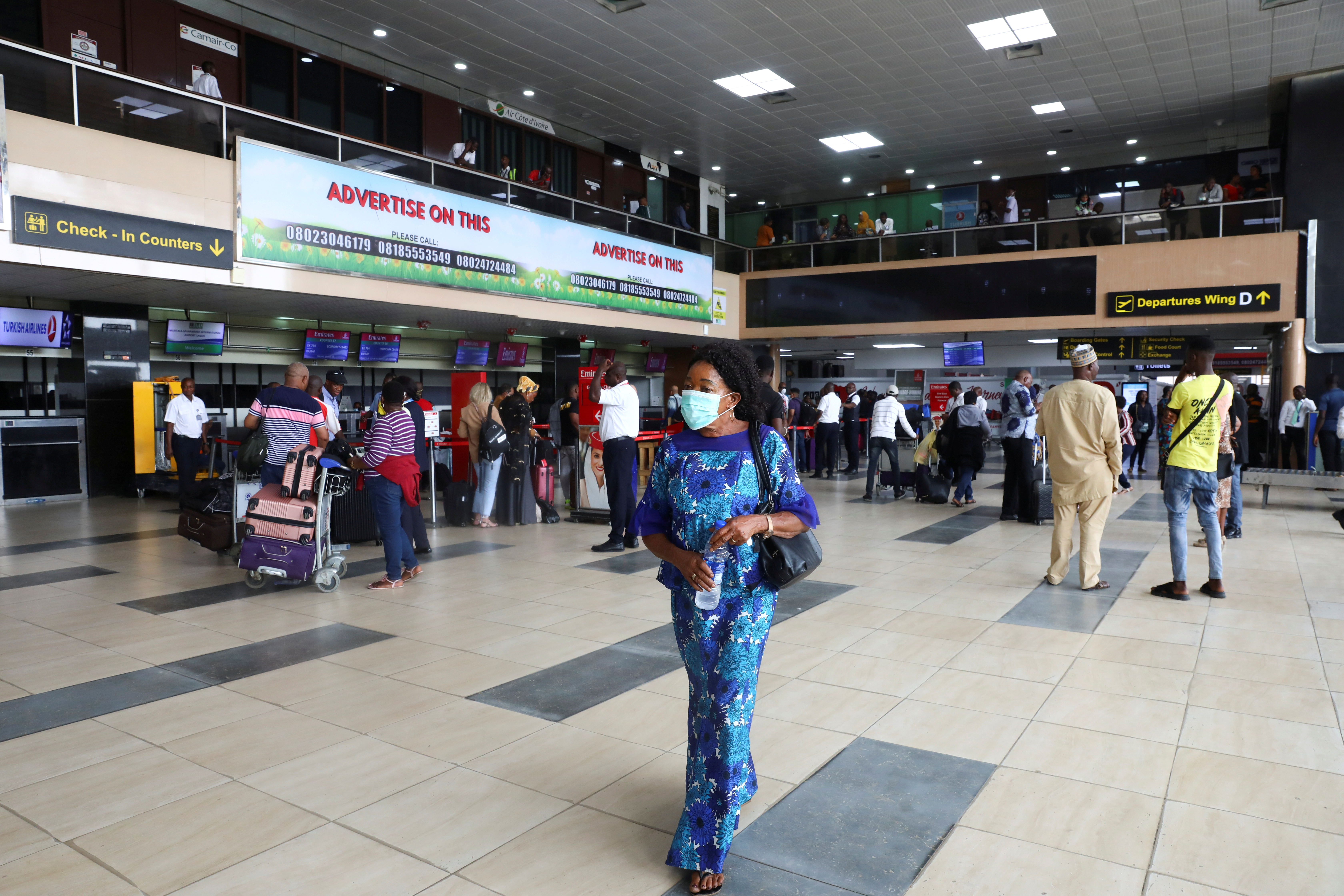 A woman wears a protective face mask due to the spread of the coronavirus disease (COVID-19), at the Murtala Mohammed International airport in Lagos, Nigeria March 19, 2020. REUTERS/Temilade Adelaja