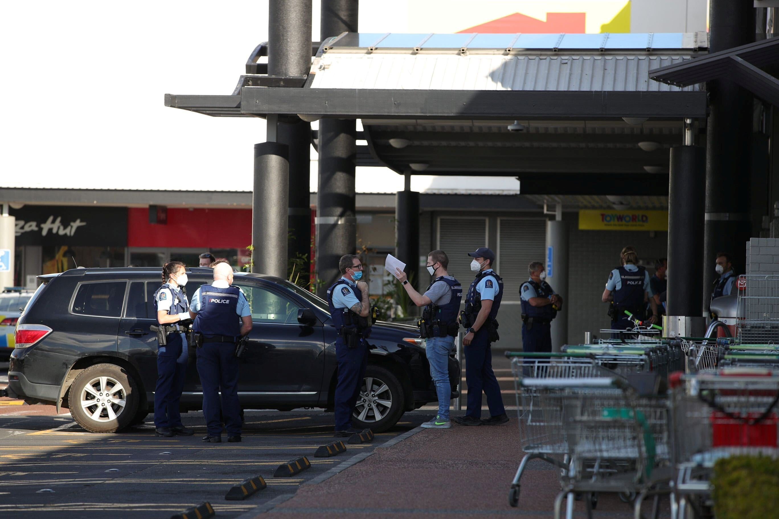 Police respond to the scene of an attack carried out by a man shot dead by police after he injured multiple people at a shopping mall in Auckland, New Zealand, September 3, 2021.  Stuff Limited/Ricky Wilson via REUTERS