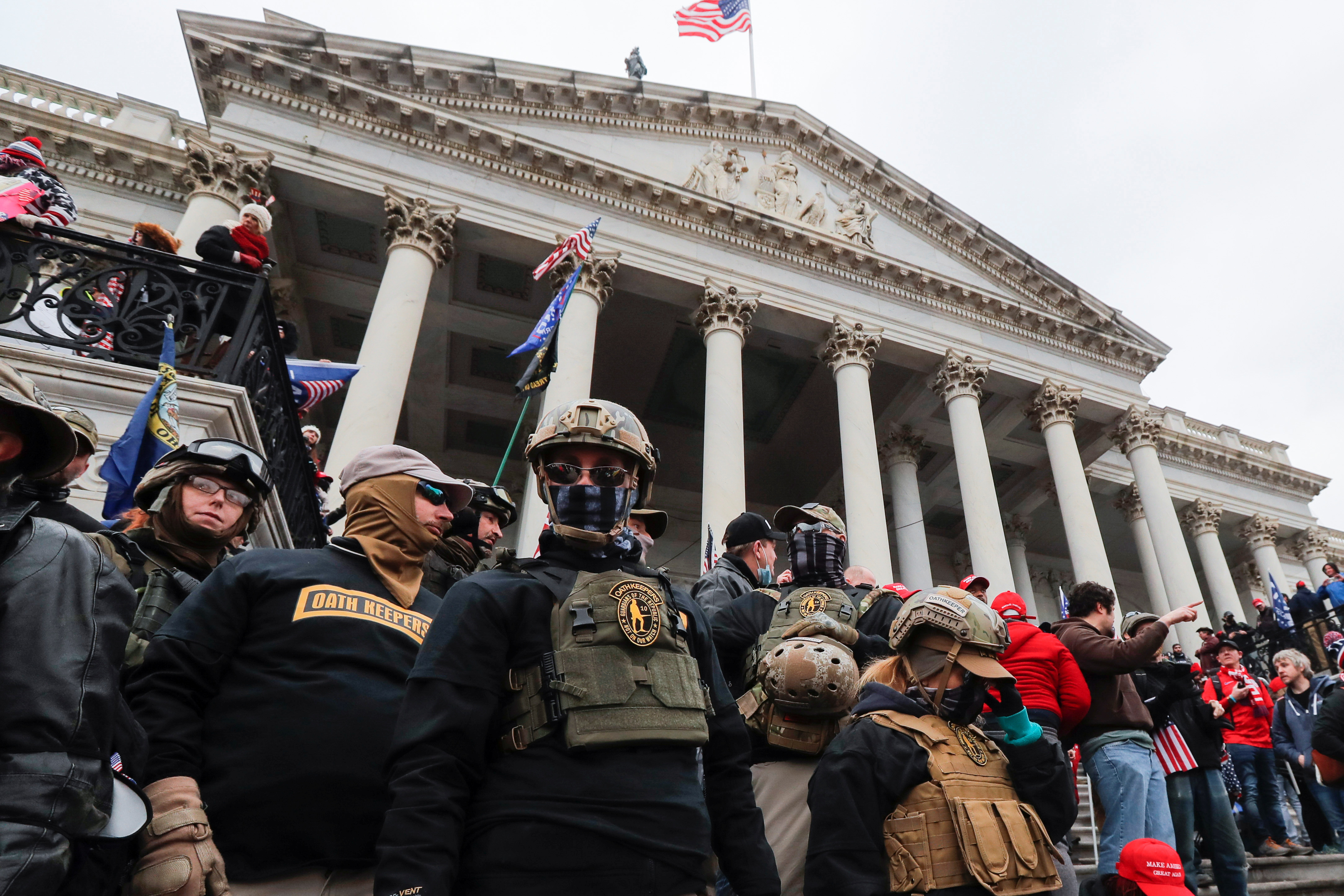 Members of the Oath Keepers militia group, including Jessica Marie Watkins (Far Left) who has since been indicted by federal authorities for her role in the siege on the Capitol, stand among supporters of U.S. President Donald Trump occupying the east front steps of the U.S. Capitol in Washington, U.S., January 6, 2021. Picture taken January 6, 2021. REUTERS/Jim Bourg
