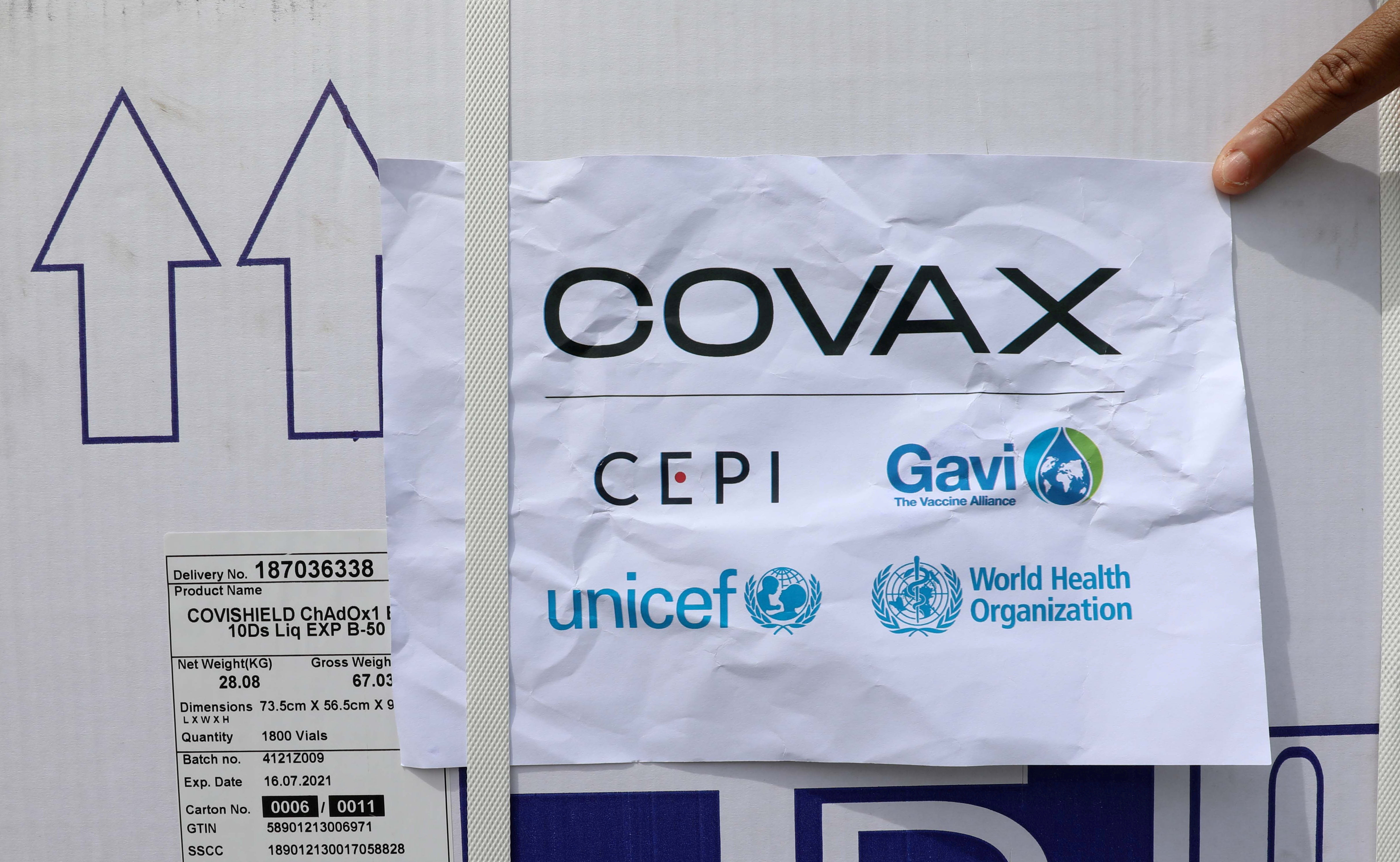Workers offload the AstraZeneca/Oxford vaccines under the COVAX scheme against coronavirus disease (COVID-19) at the Aden Abdulle Osman Airport in Mogadishu, Somalia March 15, 2021. REUTERS/Feisal Omar