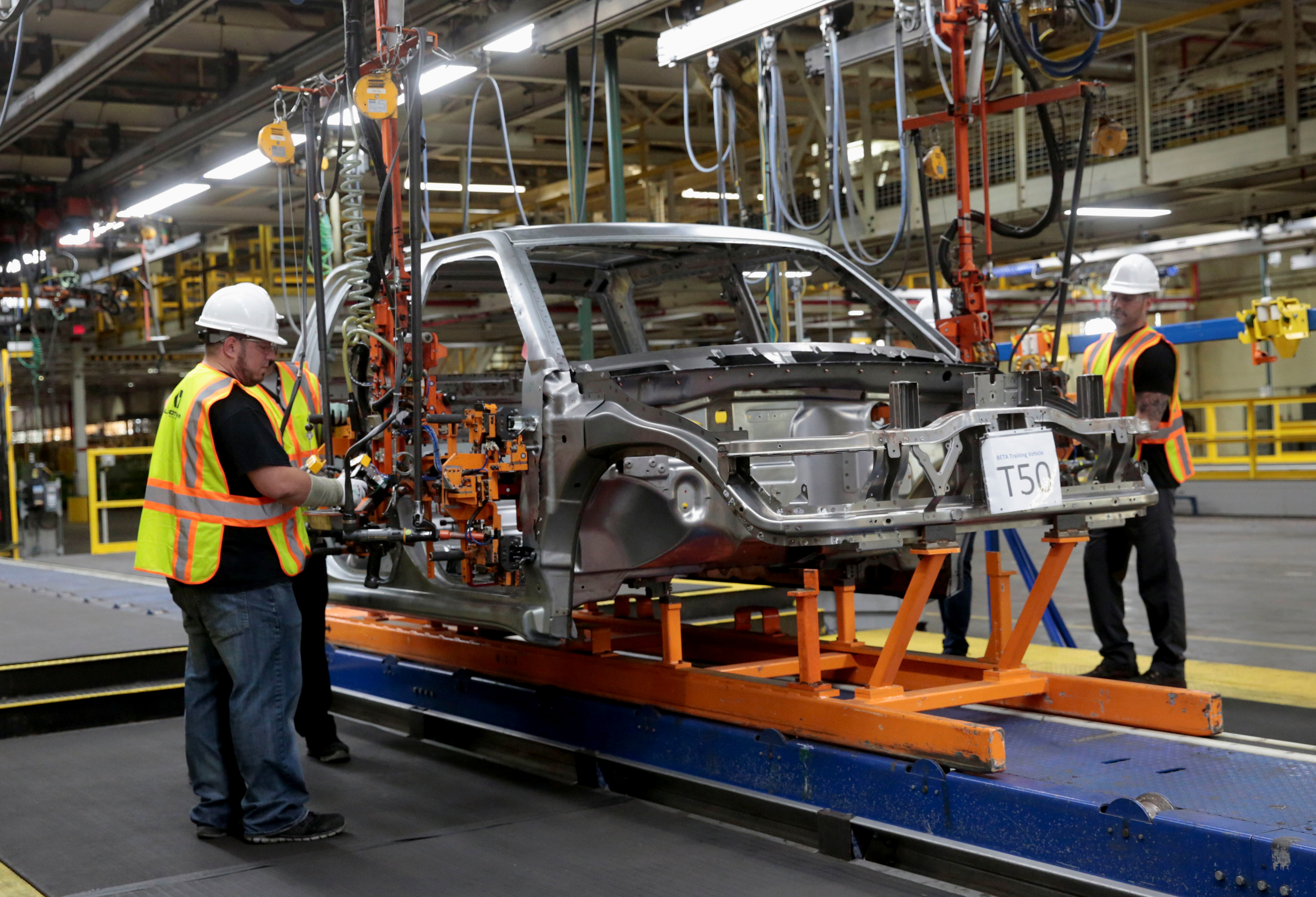 Lordstown Motors associates work on a pre-production all electric pickup truck, the Endurance, at the Lordstown Assembly Plant in Lordstown, Ohio, U.S., June 21, 2021. REUTERS/Rebecca Cook