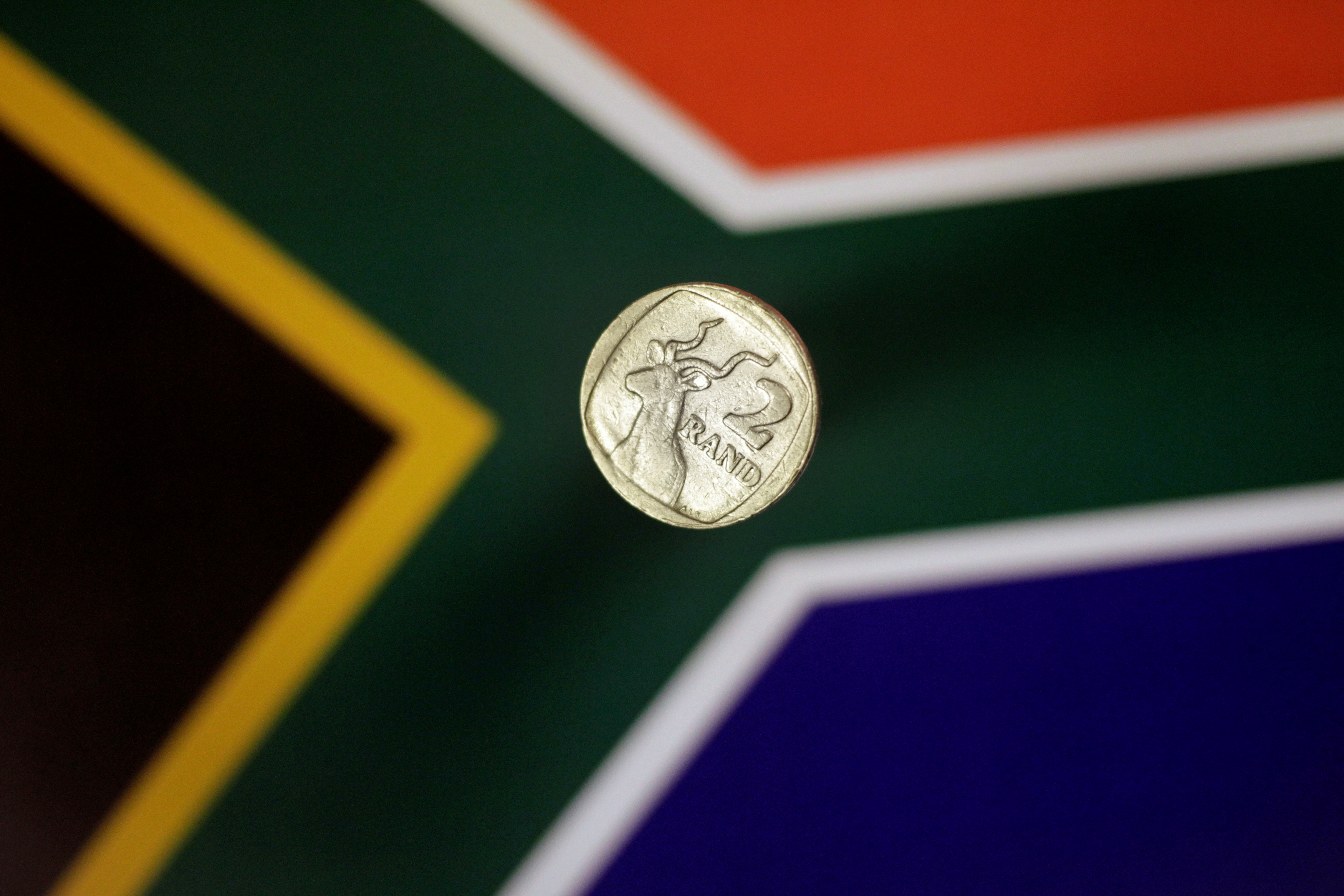 Illustration photo shows a two-rand coin above a South African flag April 12, 2017.   REUTERS/Thomas White/Illustration