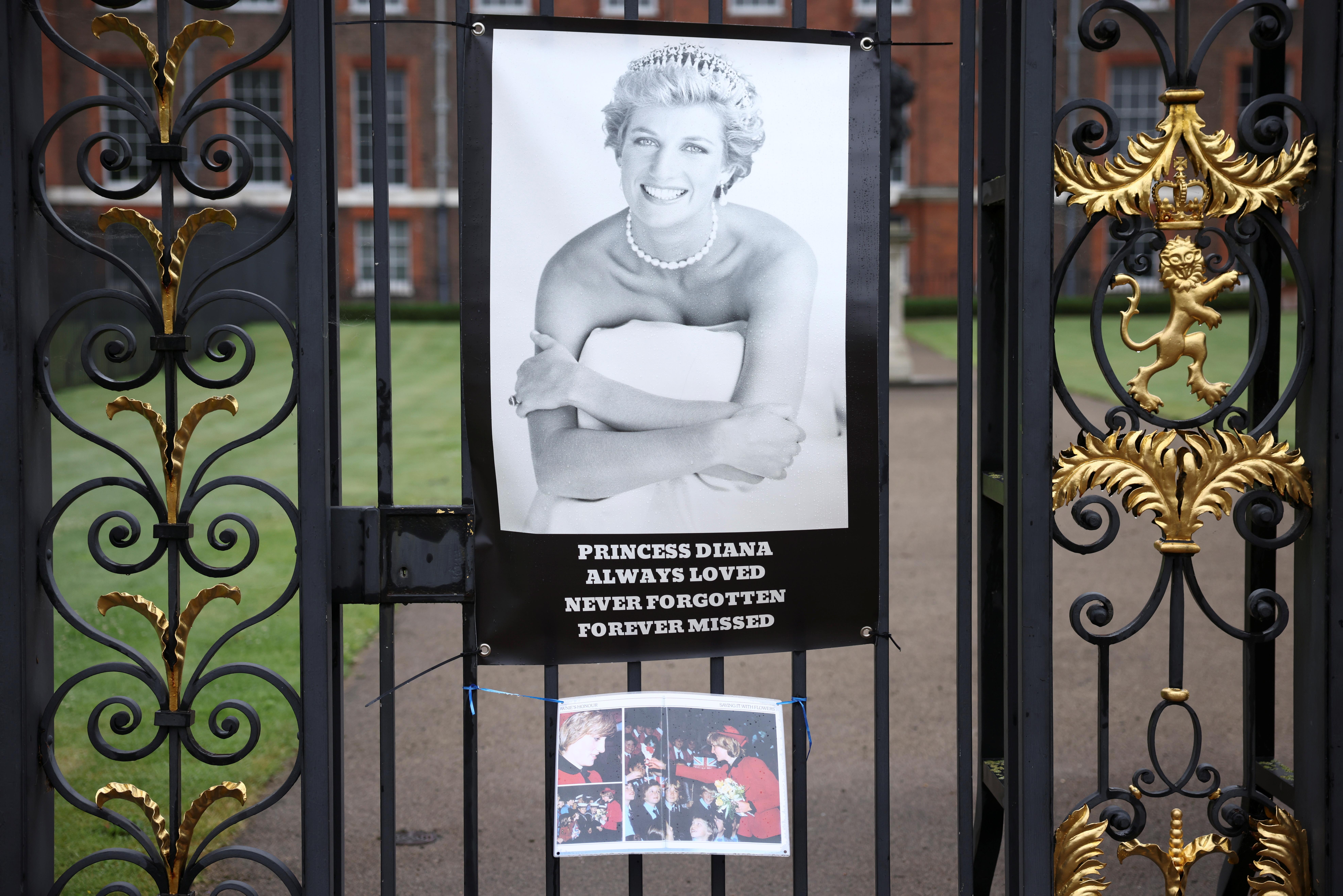 Tributes for Britain's Princess Diana hang outside Kensington Palace in London, Britain June 28, 2021. REUTERS/Henry Nicholls