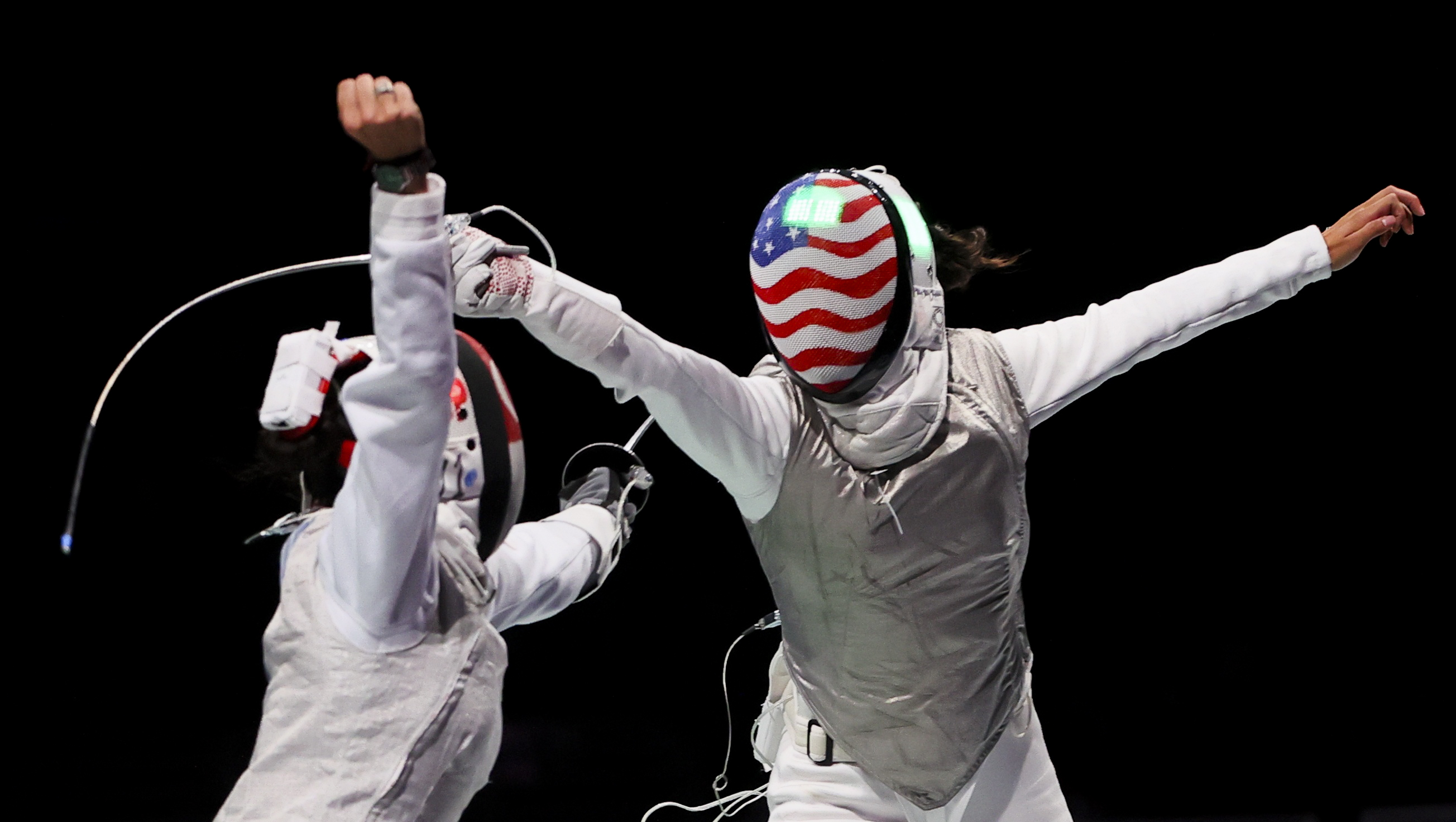 Tokyo 2020 Olympics - Fencing - Women's Individual Foil - Last 32 - Makuhari Messe Hall B - Chiba, Japan - July 25, 2021. Lee Kiefer of the United States in action against Amita Berthier of Singapore REUTERS/Maxim Shemetov