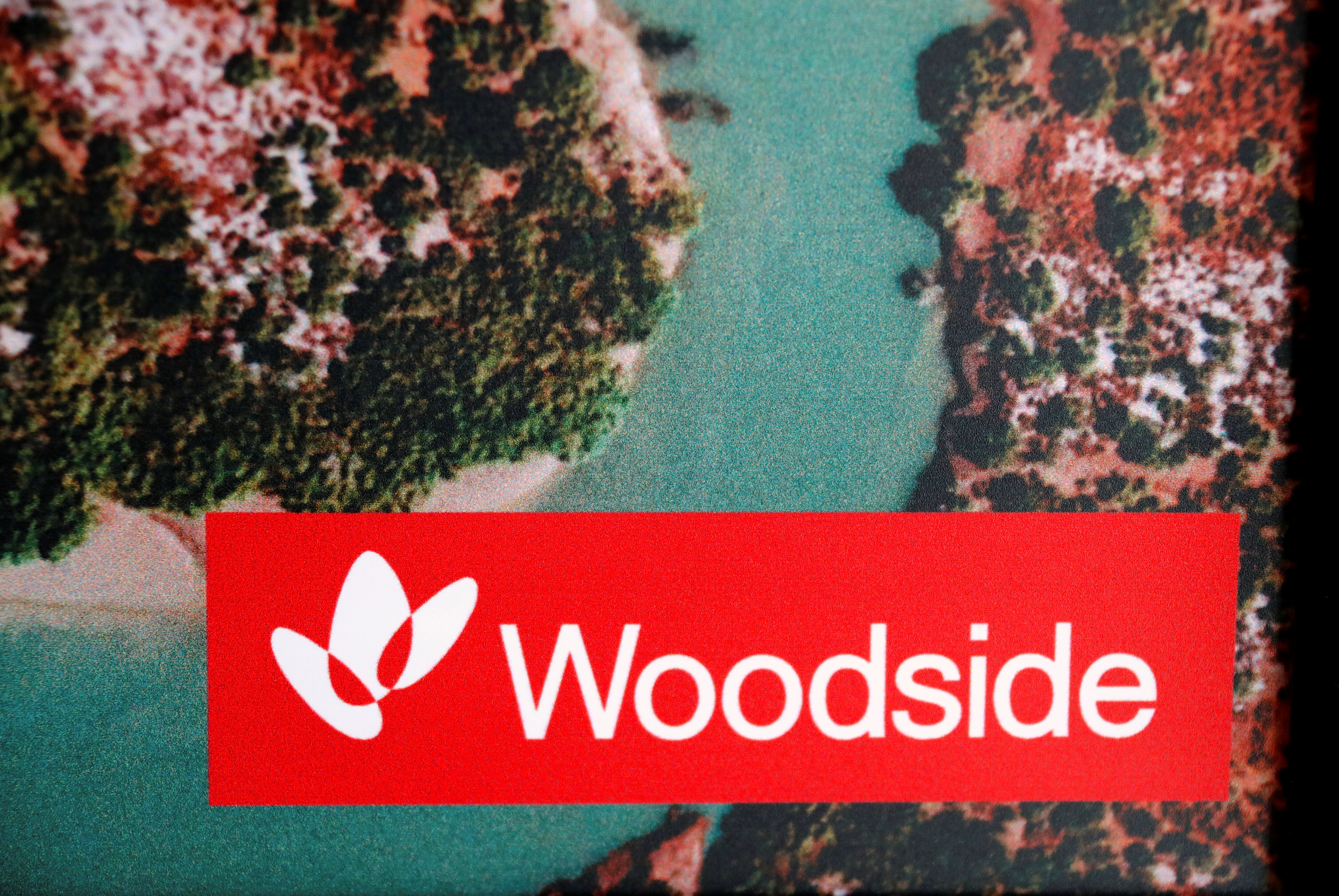 The logo for Woodside Petroleum, Australia's top independent oil and gas company, adorns a promotional poster on display at a briefing for investors in Sydney, Australia, May 23, 2018.   REUTERS/David Gray