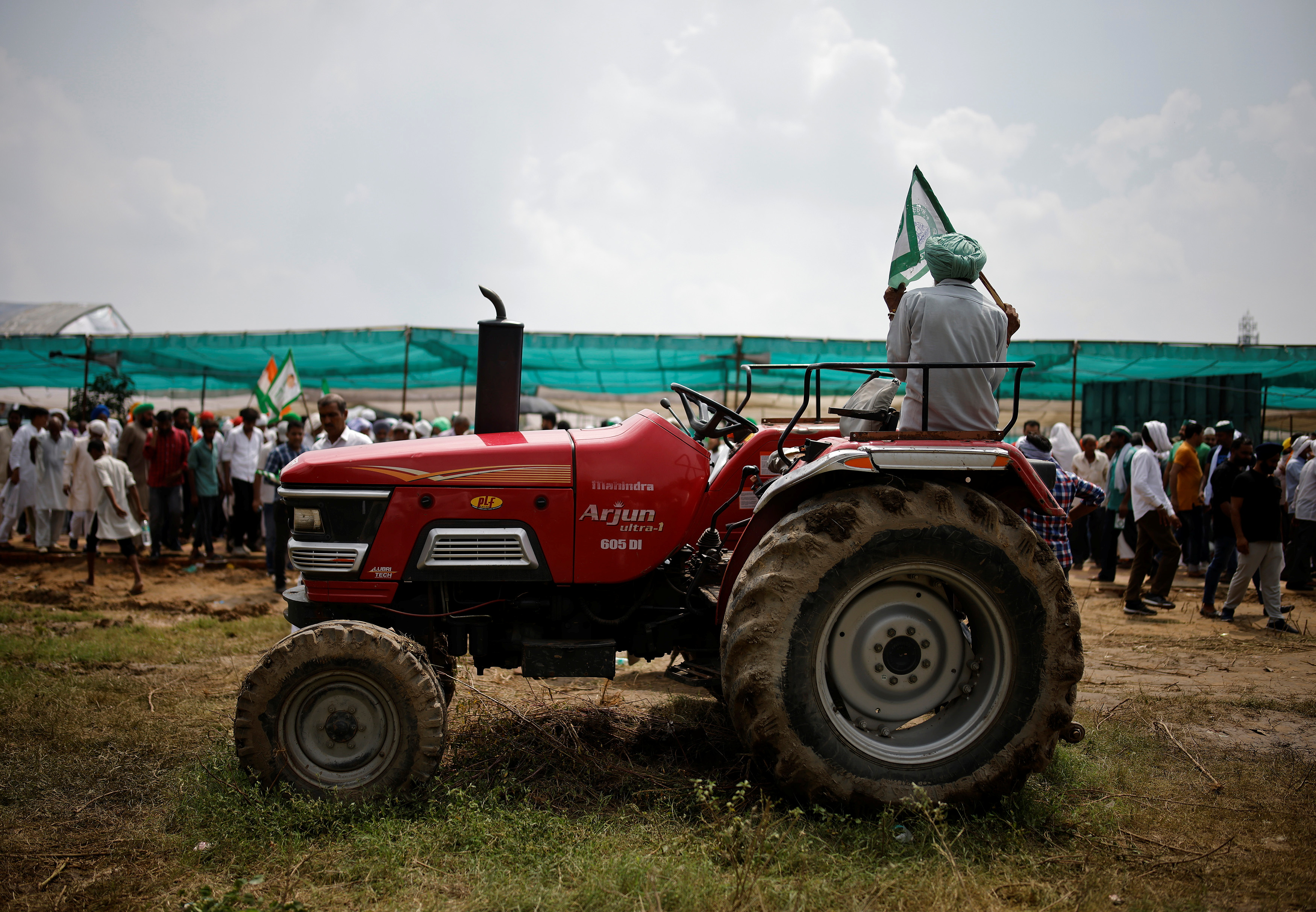 A farmer sits on a tractor as he attends a Maha Panchayat or grand village council meeting as part of a protest against farm laws in Muzaffarnagar in the northern state of Uttar Pradesh, India, September 5, 2021. REUTERS/Adnan Abidi