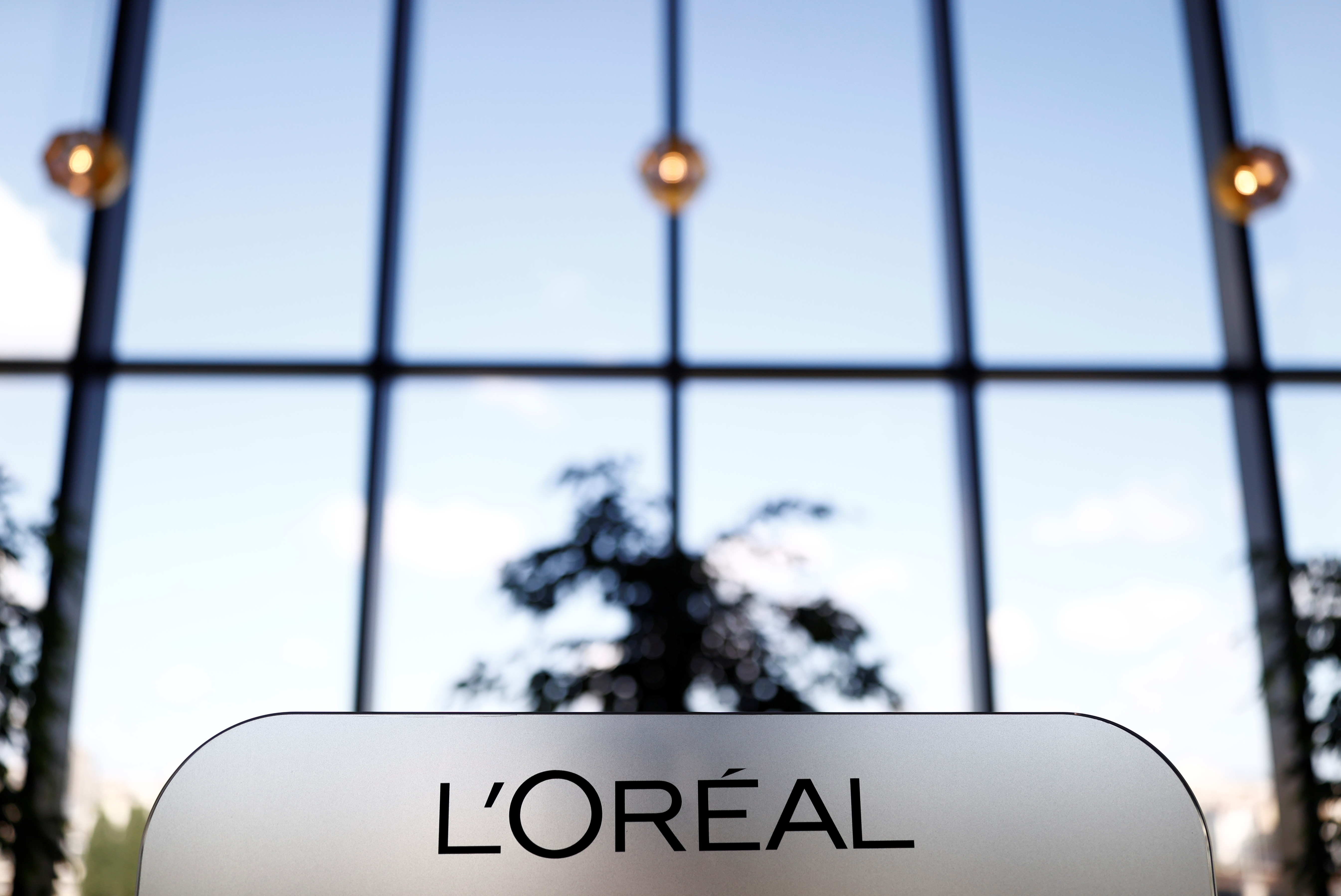 A L'Oreal logo is seen at the company's offices in Levallois-Perret, near Paris, France, May 7, 2021. REUTERS/Christian Hartmann