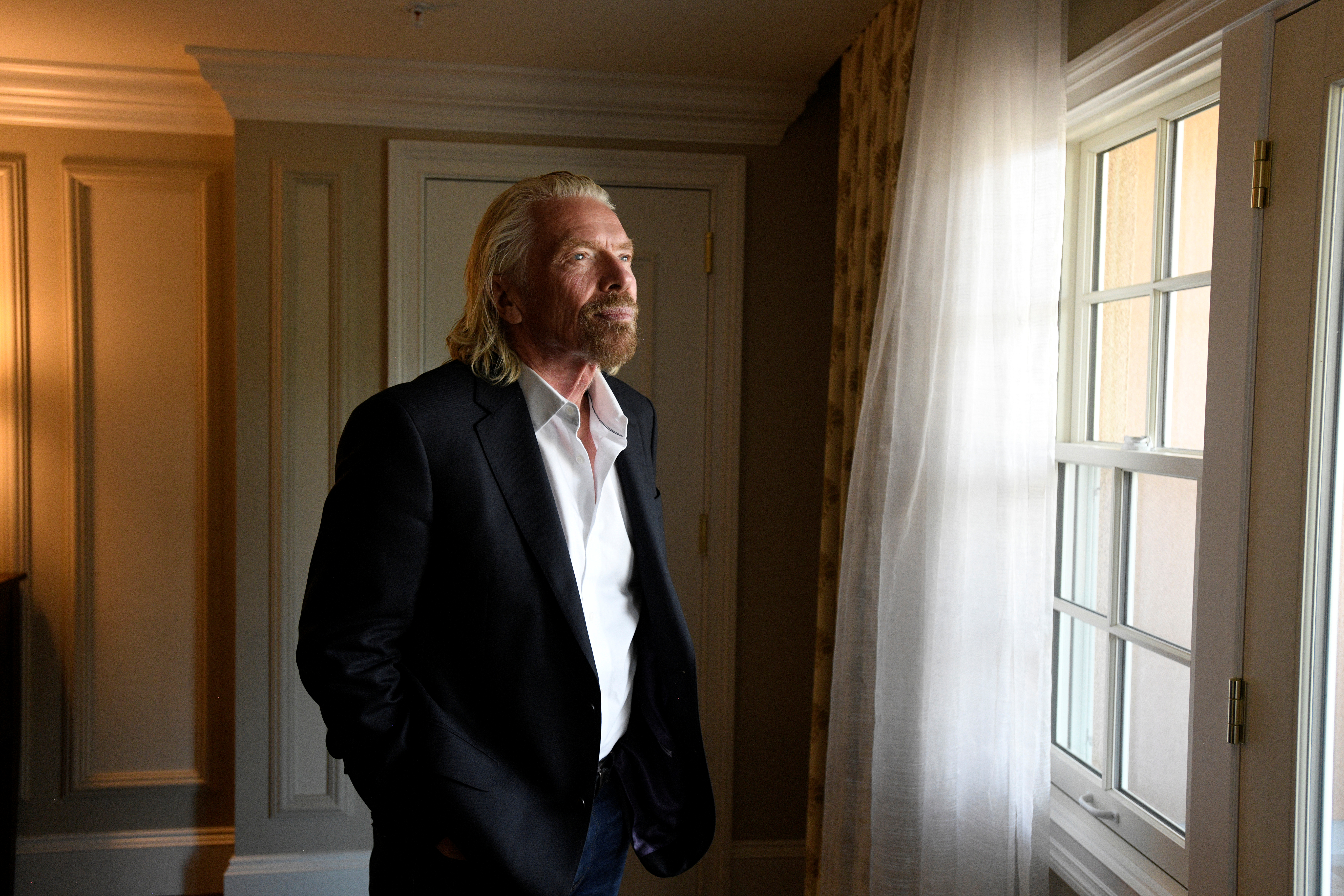 Virgin Galactic founder Richard Branson poses for a portrait in his suite at the Broadmoor Hotel during the Space Symposium in Colorado Springs, Colorado, U.S., April 11, 2019. REUTERS/Kelsey Brunner