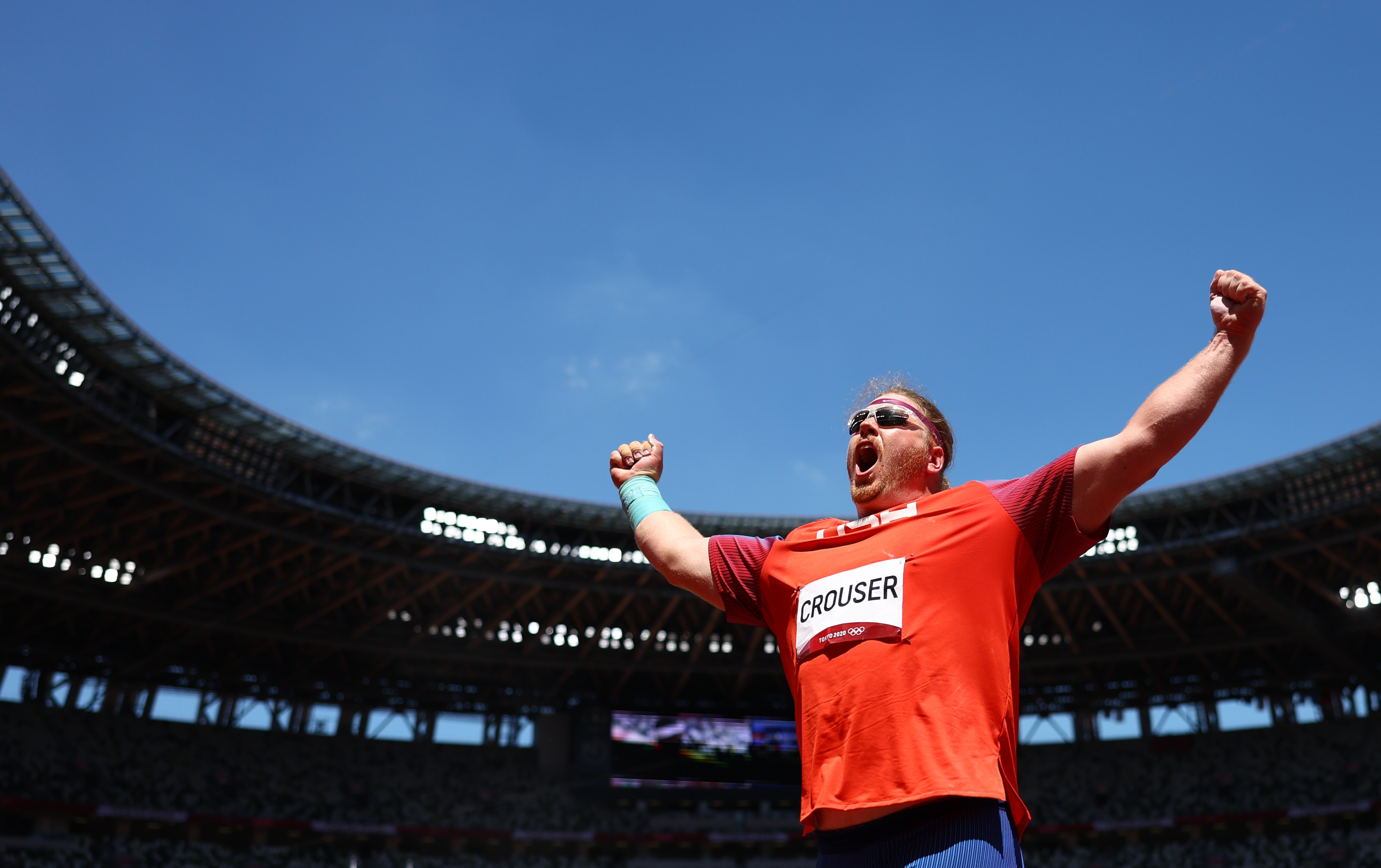 Tokyo 2020 Olympics - Athletics - Men's Shot Put - Final - Olympic Stadium, Tokyo, Japan - August 5, 2021. Ryan Crouser of the United States celebrates after winning gold and a new Olympic Record REUTERS/Kai Pfaffenbach
