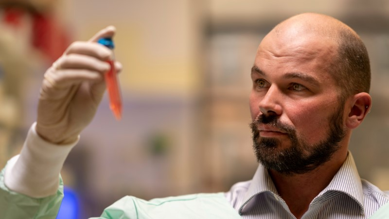 Professor David Nisbet from Australian National University (ANU) holds a vial as researchers from ANU developed a new type of hydrogel that could help to defeat Parkinson's disease, in this undated handout picture. AUSTRALIAN NATIONAL UNIVERSITY/Jamie Kidston/Handout via REUTERS