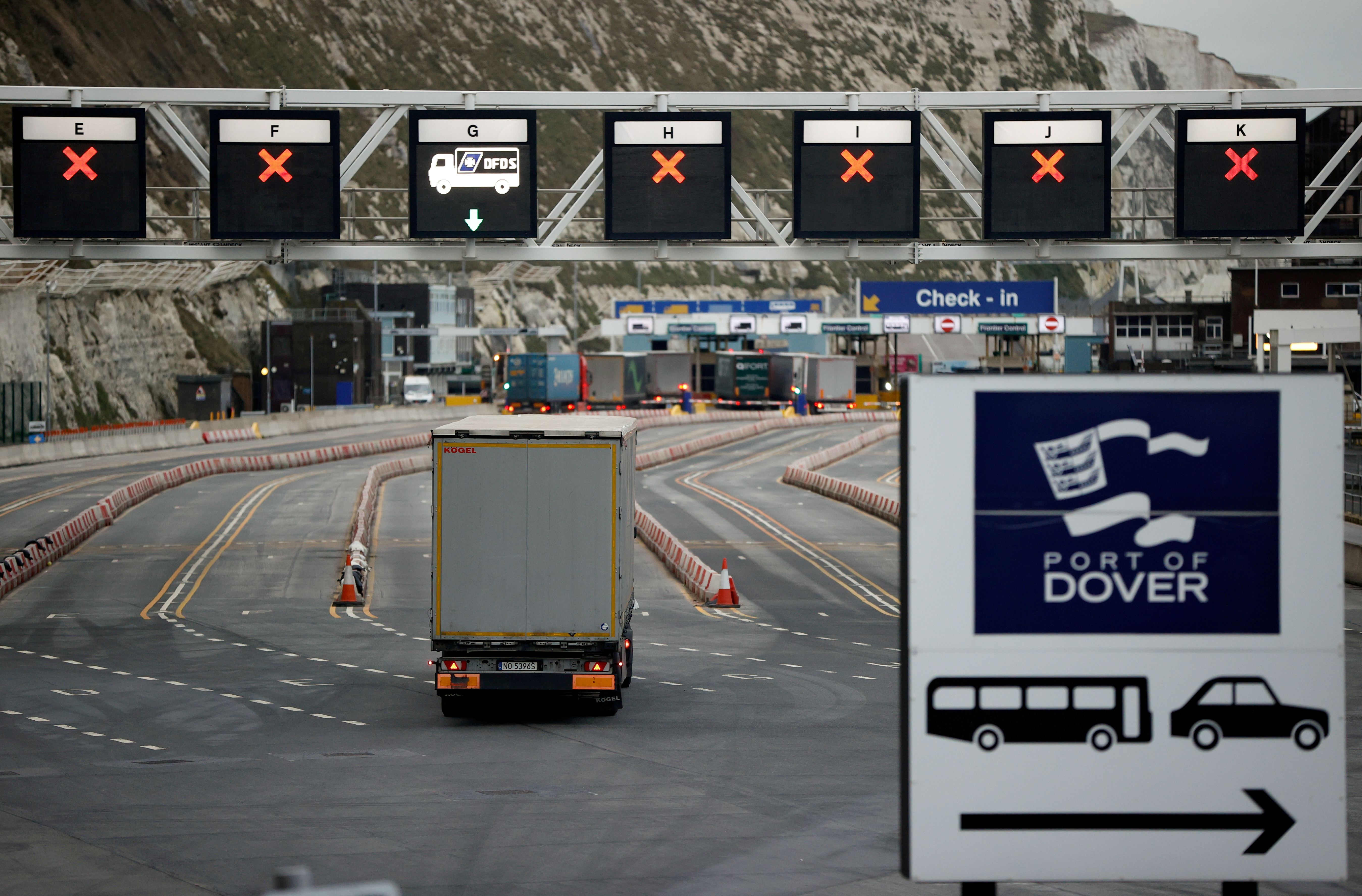 A truck drives towards the entrance to the Port of Dover, following the end of the Brexit transition period, in Dover, Britain, January 15, 2021. REUTERS/John Sibley//File Photo