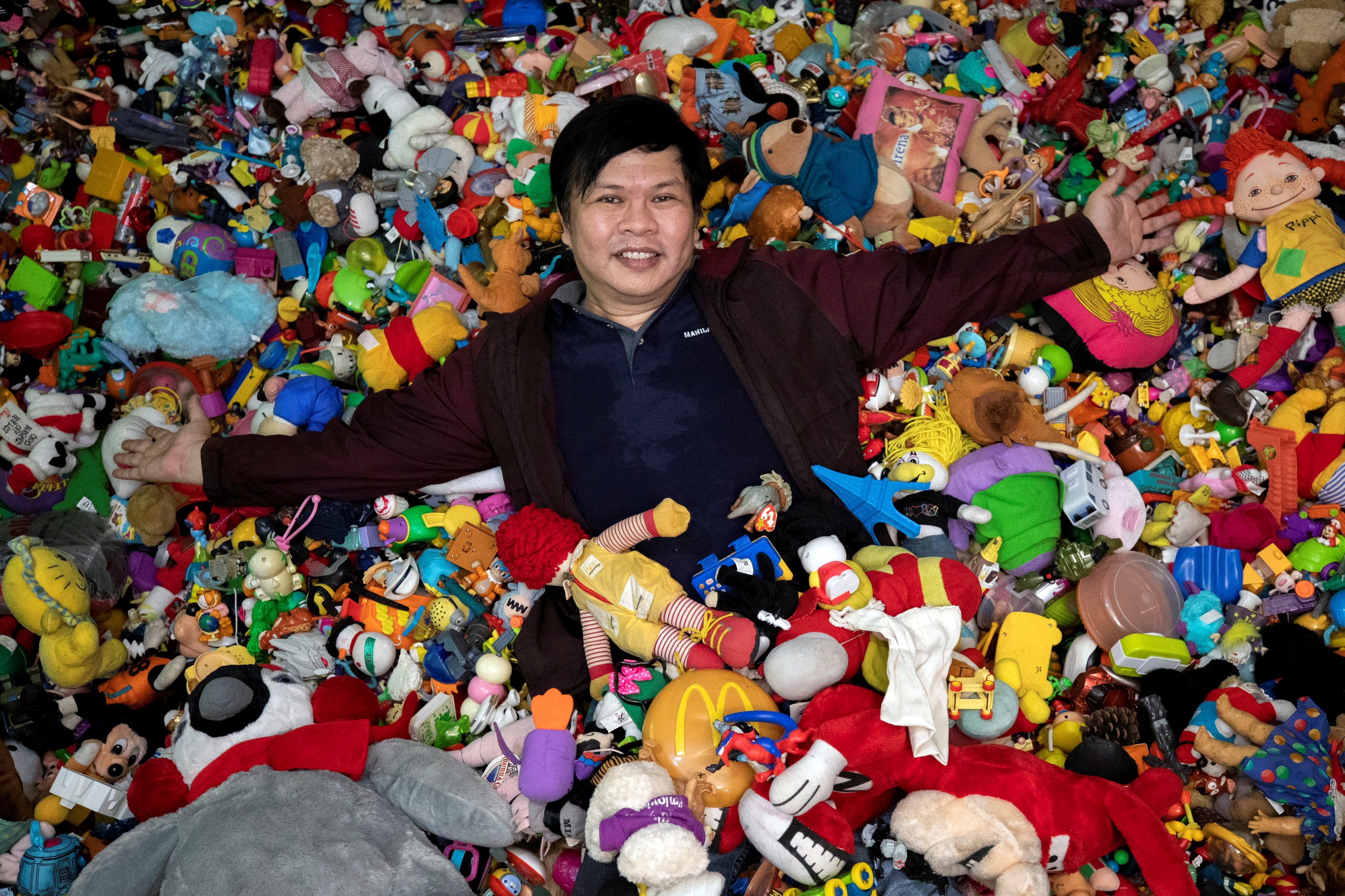 Percival Lugue, who has the Guinness world record for the largest fast-food toy collection, poses with his toy collection in his home in Apalit, Pampanga province, Philippines, April 20, 2021. REUTERS/Eloisa Lopez