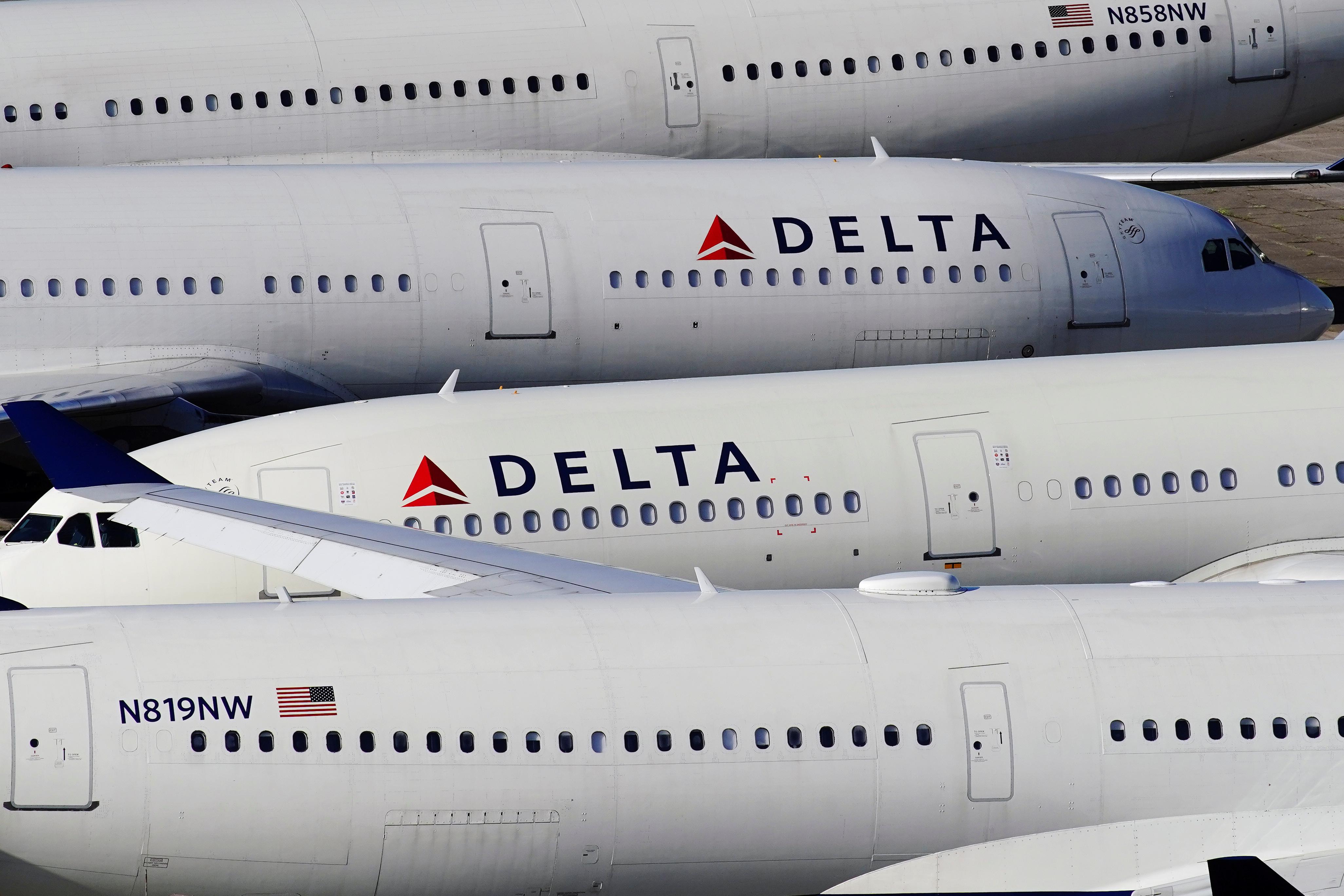 Delta Air Lines passenger planes are seen parked at Birmingham-Shuttlesworth International Airport in Birmingham, Alabama, U.S. March 25, 2020.  REUTERS/Elijah Nouvelage