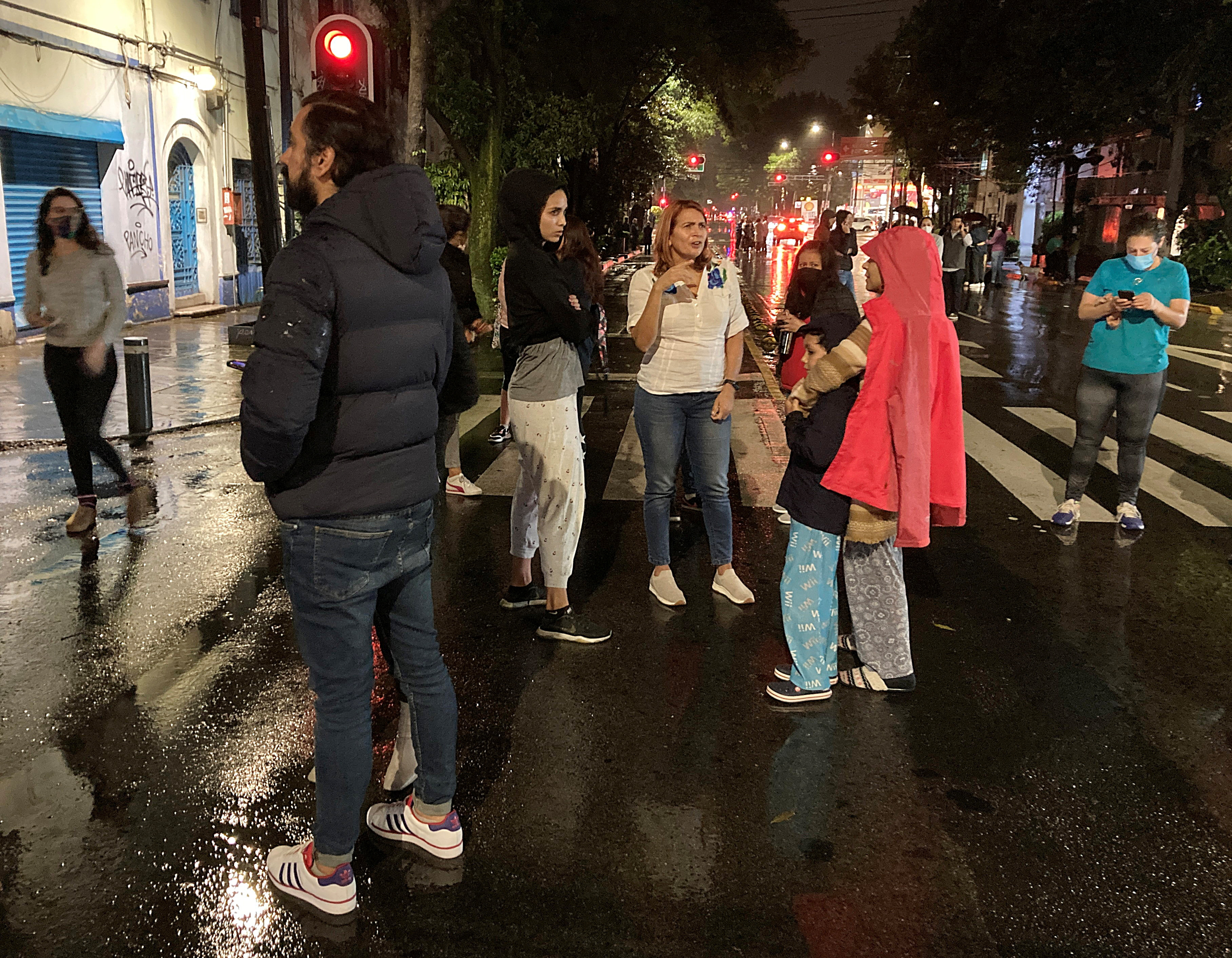People stand in the street after a quake shook buildings in Mexico City, Mexico, September 7, 2021. REUTERS/Andres Stapff