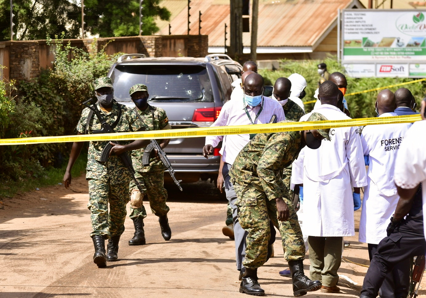 Security forces and forensic experts secure the scene of an attempted assassination on Ugandan minister of works and transport General Katumba Wamala in the suburb of Kiasasi within Kampala, Uganda June 1, 2021. REUTERS/Abubaker Lubowa